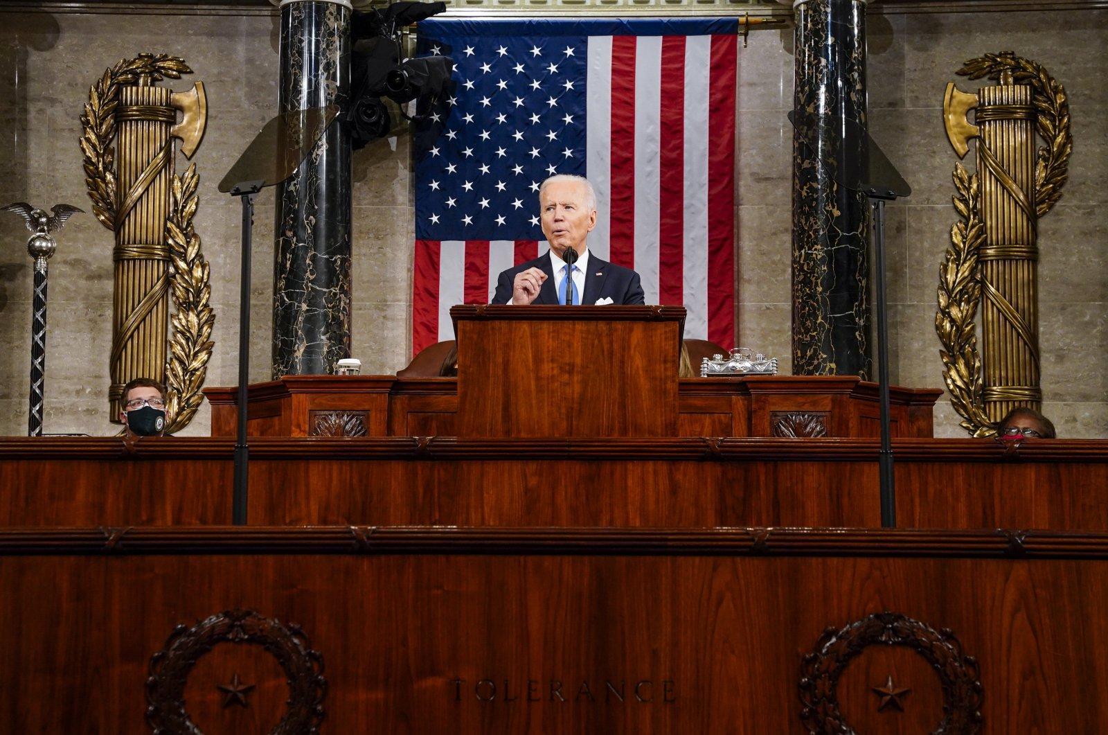 U.S. President Joe Biden addresses a joint session of Congress, with Vice President Kamala Harris and House Speaker Nancy Pelosi behind him, at the Capitol in Washington, D.C., U.S., April 28, 2021. (EPA Photo)