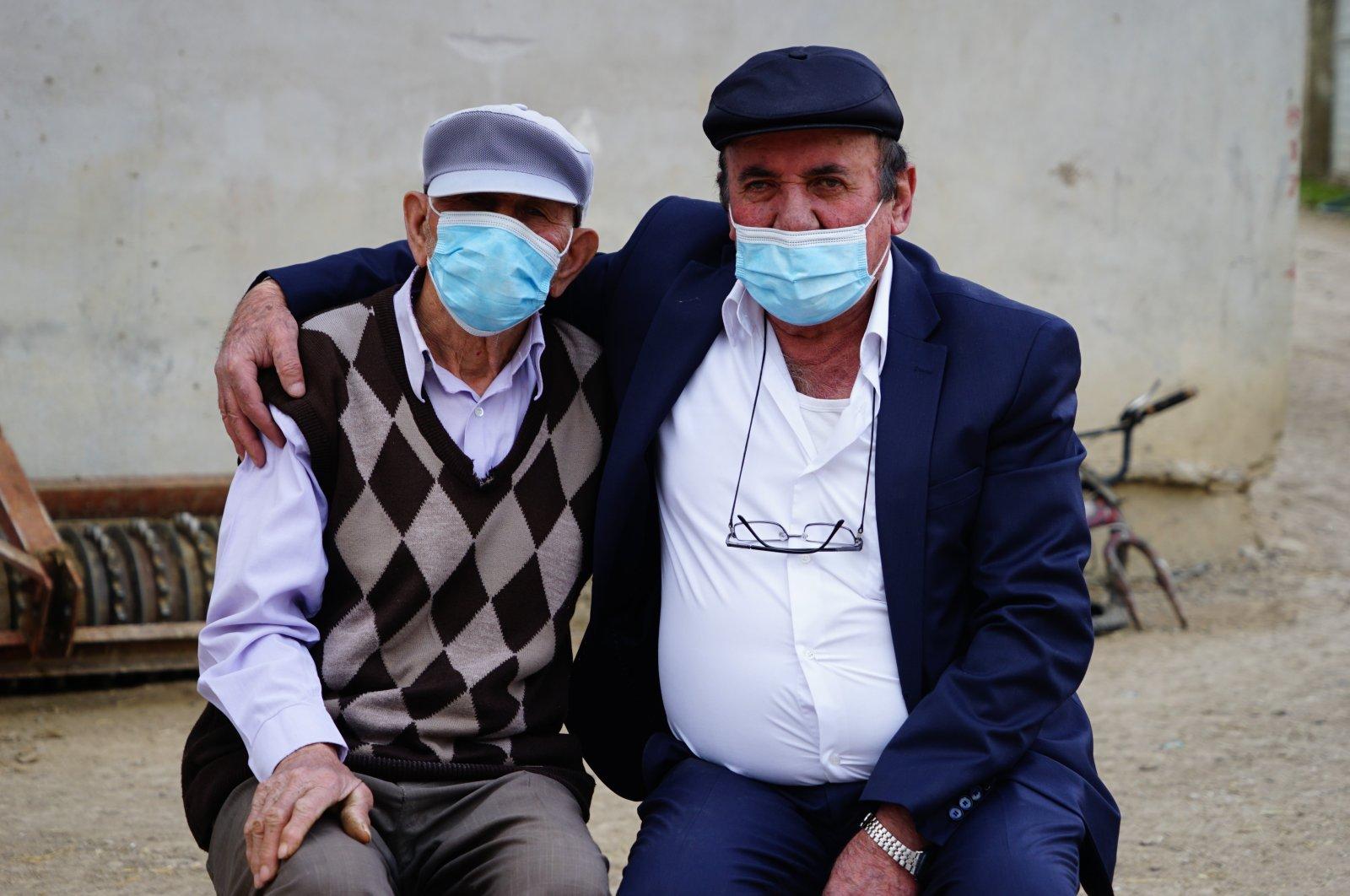 Hakkı Öksüzoğlu (L) and Muammer Terzioğlu pose together in Kastamonu, a city in northwestern Turkey, April 30, 2021. (IHA Photo)