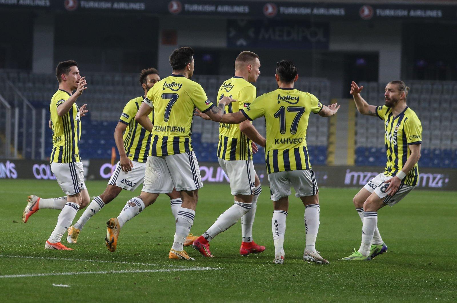 Fenerbahçe players celebrate a goal against Başakşehir in a Süper Lig match, Istanbul, Turkey, April 18, 2021.