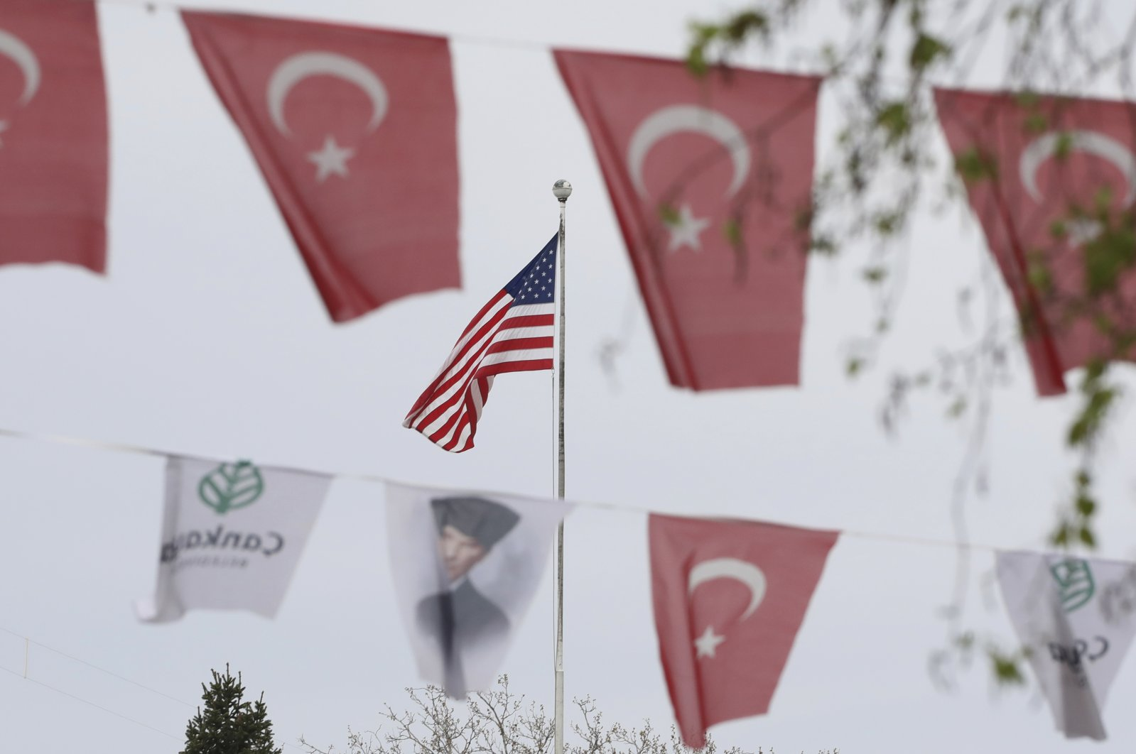 Turkish flags and banners depicting Mustafa Kemal Ataturk, the founder of modern Turkey, decorate a street outside the United States Embassy in capital Ankara, Turkey, April 25, 2021. (AP Photo)