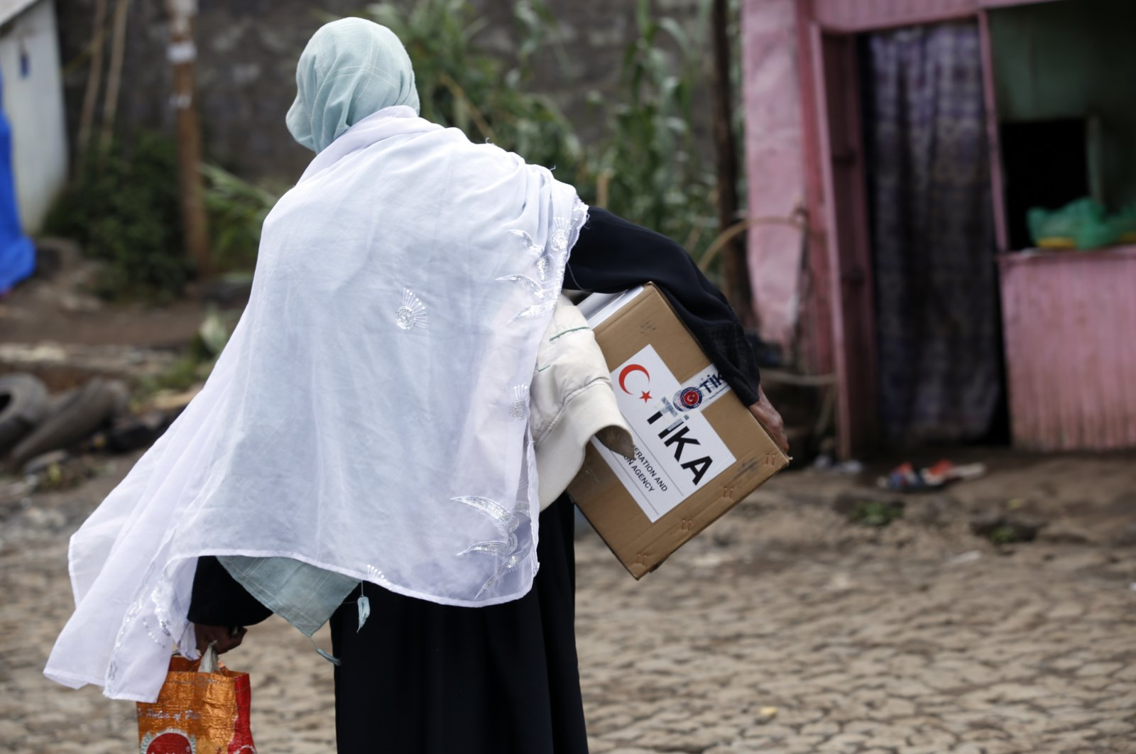 An Ethiopian woman carries an aid package delivered by TIKA in Addis Ababa, Ethiopia, April 29, 2021. (AA)