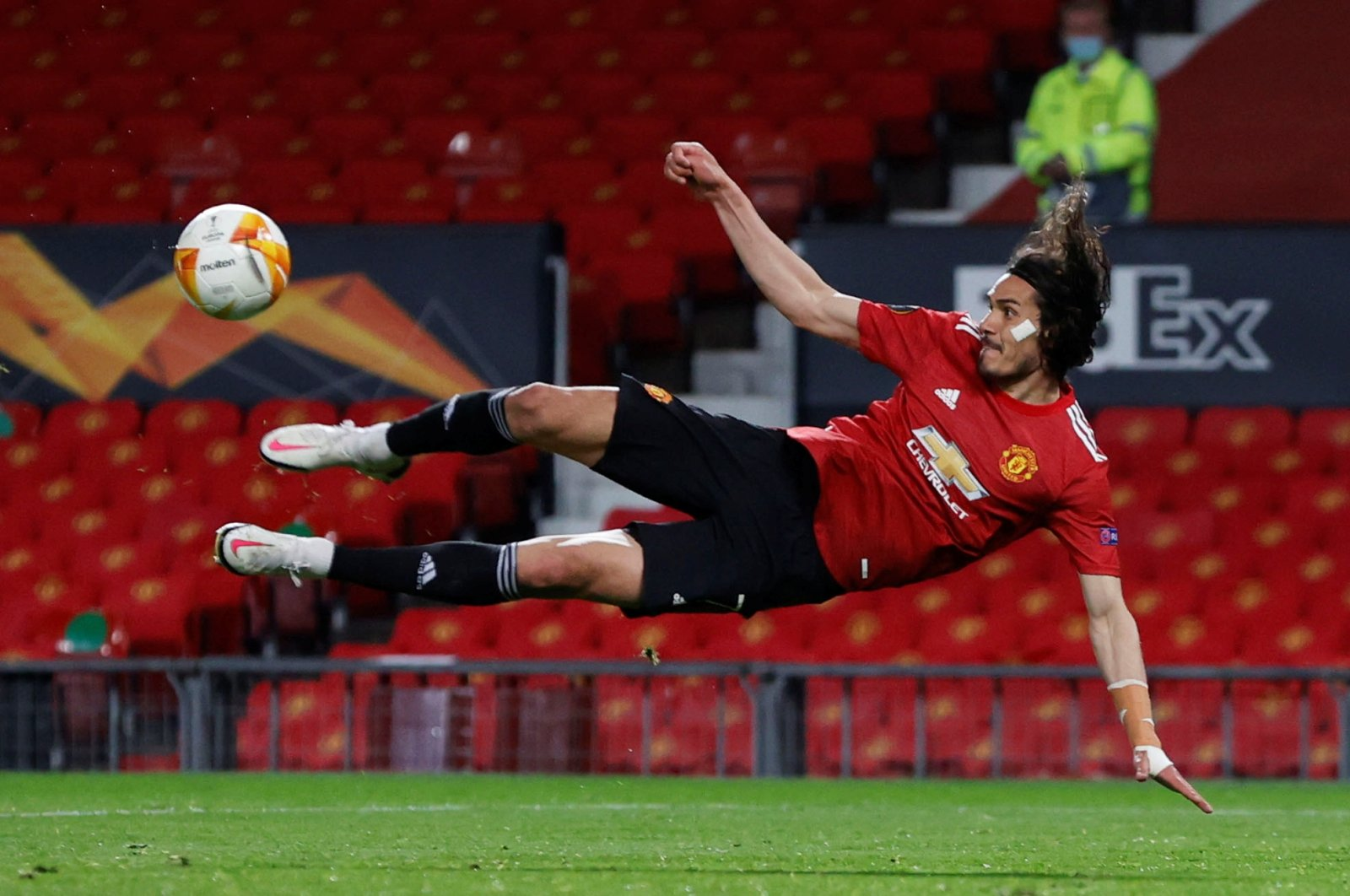 Manchester United's Edinson Cavani shoots at goal during a Europa League semifinal, first leg match against AS Roma at Old Trafford, Manchester, Britain, April 29, 2021. (Reuters Photo)