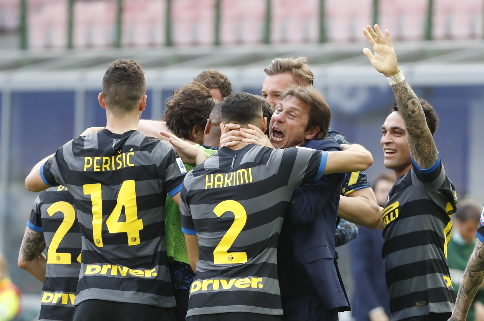 Inter Milan head coach Antonio Conte and players celebrate after Matteo Darmian scored during a Serie A match against Hellas Verona, at the San Siro, Milan, Italy, April 25, 2021. (AP Photo)