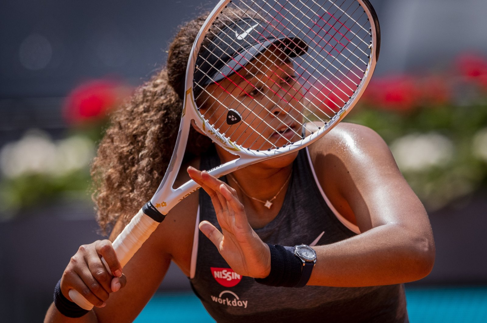 Japan's Naomi Osaka returns the ball to Japan's Misaki Doi during their match at the Madrid Open tennis tournament in Madrid, Spain, April 30, 2021. (AP Photo)