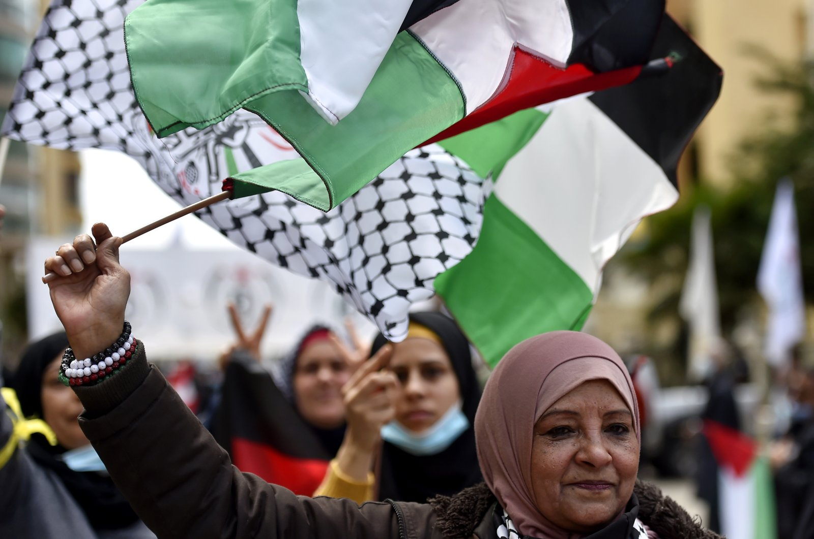 Palestinian refugees carry national flags as they shout slogans during a protest outside of the Palestinian Embassy in Beirut, Lebanon, 12 April 2021. (EPA Photo)