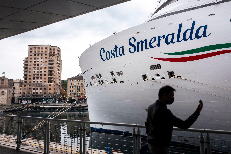 A man gestures near the Costa Smeralda cruise ship docked in Savona, near Genoa, Italy, May 1, 2021. (AFP Photo)