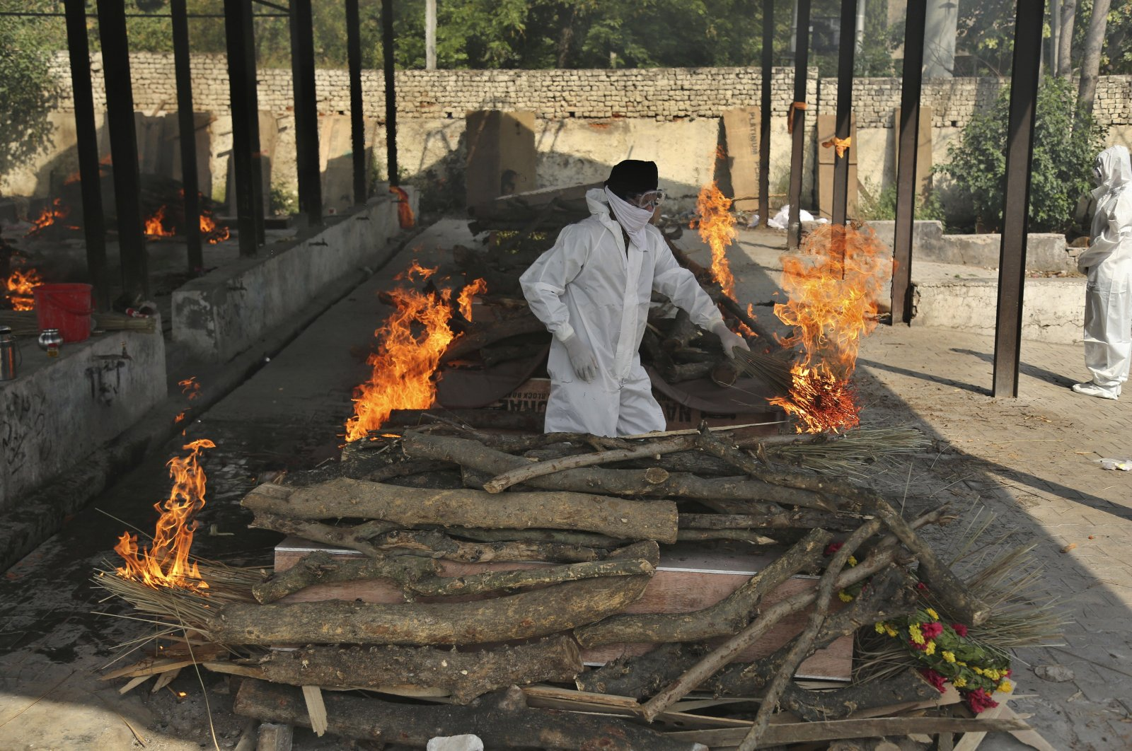 A family member performs the last rites of a COVID-19 victim at a crematorium in Jammu, India, April 30, 2021. (AP Photo)
