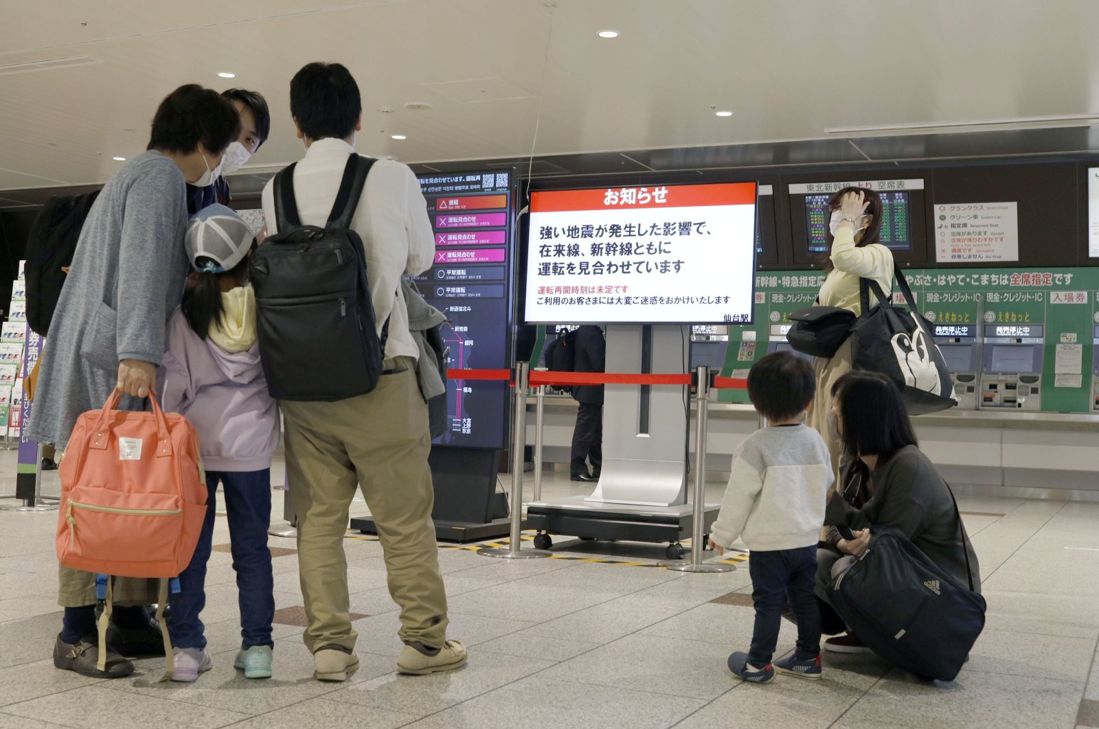People gather around a ticket gate as train services are suspended following an earthquake in Sendai, Miyagi prefecture, Japan, May 1, 2021. (Kyodo via Reuters)
