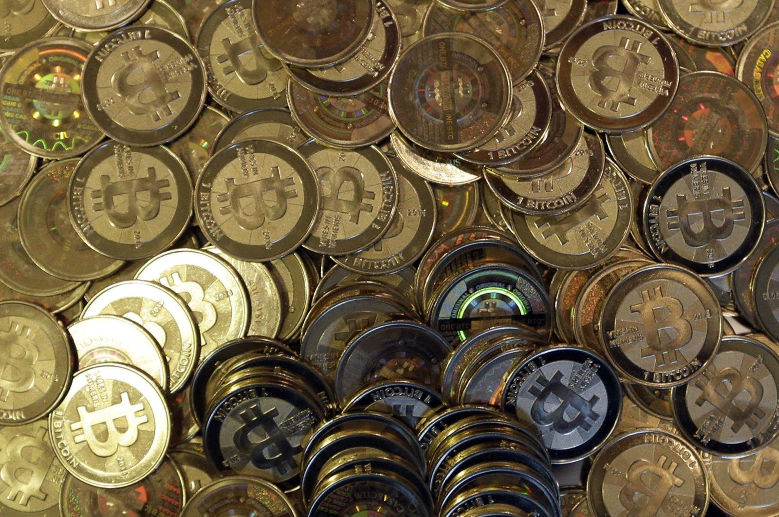 Bitcoin tokens are seen in Sandy, Utah, U.S., April 3, 2013. (AP Photo)