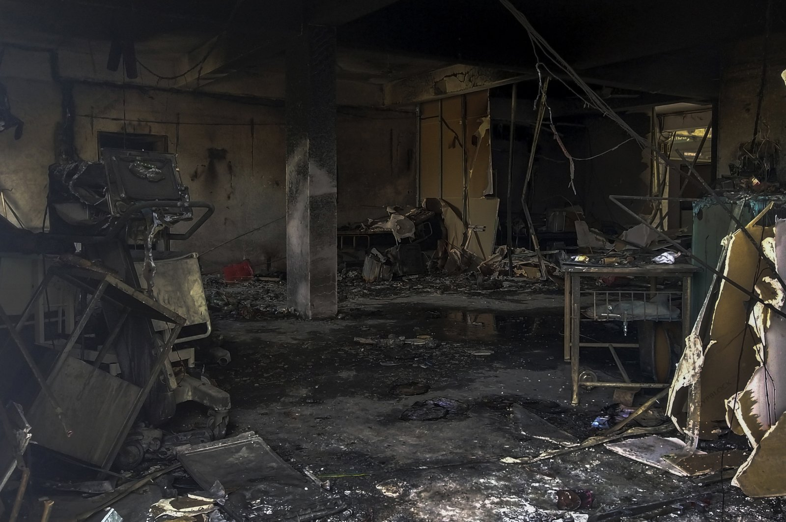 Charred furniture and other items are seen after a deadly fire at the Welfare Hospital in Bharuch, western India, Saturday, May 1, 2021. (AP Photo)