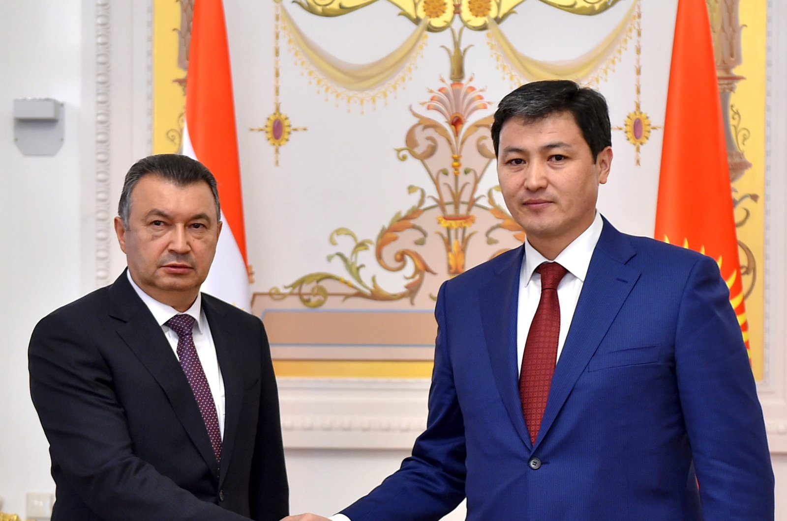 Tajik Prime Minister Kohir Rasulzoda (L) and Kyrgyz Prime Minister Ulukbek Maripov shake hands during a bilateral meeting before a session of the Eurasian Economic Union (EAEU) Intergovernmental Council in Kazan, Russia, April 29, 2021. (EPA Photo)