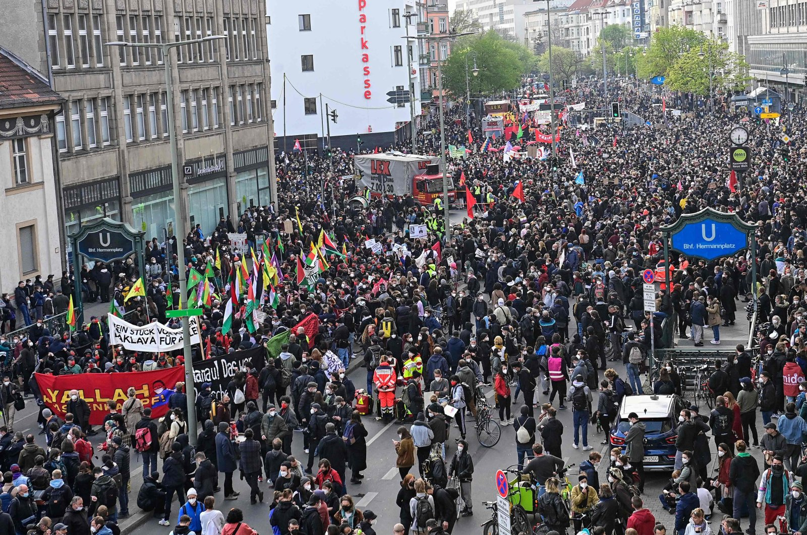 """YPG/PKK terrorist group banners are displayed during the so-called """"Revolutionary Mayday"""" demonstration at Hermannplatz in the Kreuzberg district of Berlin, Germany, May 1, 2021. (AFP Photo)"""
