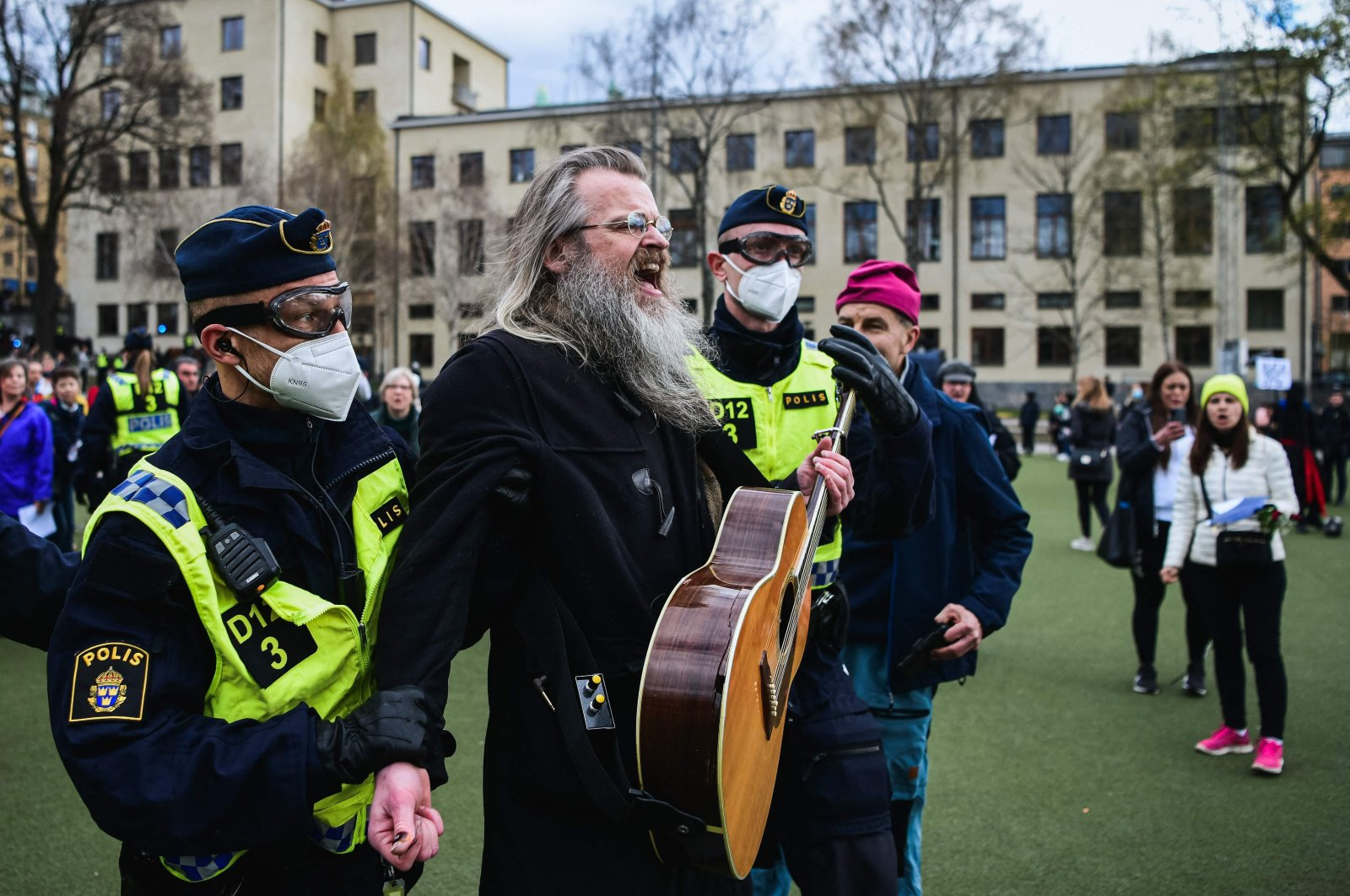 Police officers remove people as they gather to protest against the country's COVID-19 restrictions in central Stockholm, Sweden, May 1, 2021. (AFP Photo)