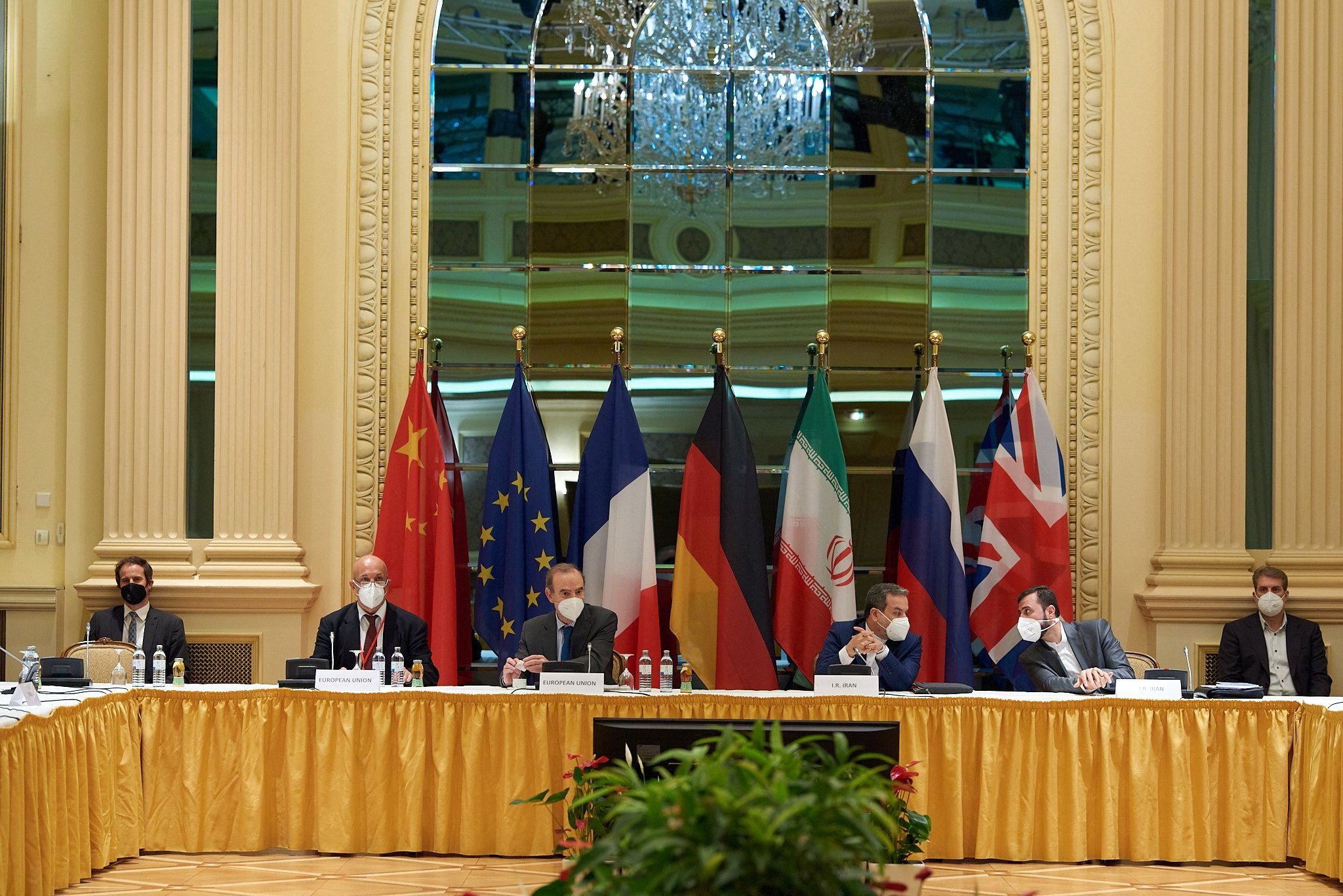 Delegation members from the remaining parties to the Iran nuclear deal – Germany, France, Britain, China, Russia and Iran – attend a meeting as they try to restore the deal, at the Grand Hotel of Vienna, in Vienna, Austria, May 1, 2021. (Photo by Handout / EU delegation in Vienna / AFP)