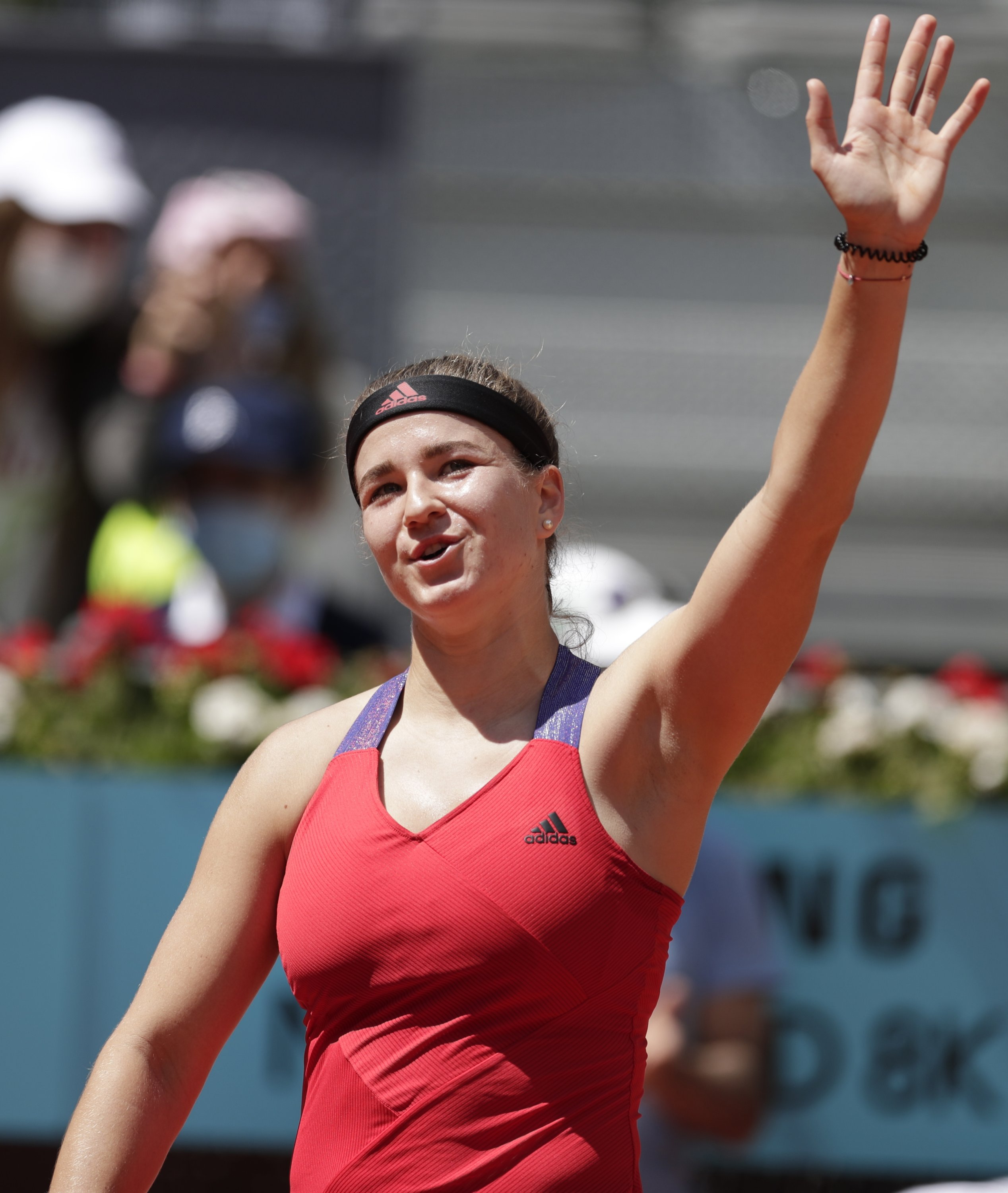 The Czech Republic's Karolina Muchova celebrates after defeating Japan's Naomi Osaka in the Madrid Open second round, Madrid, Spain, May 2, 2021. (AP Photo)