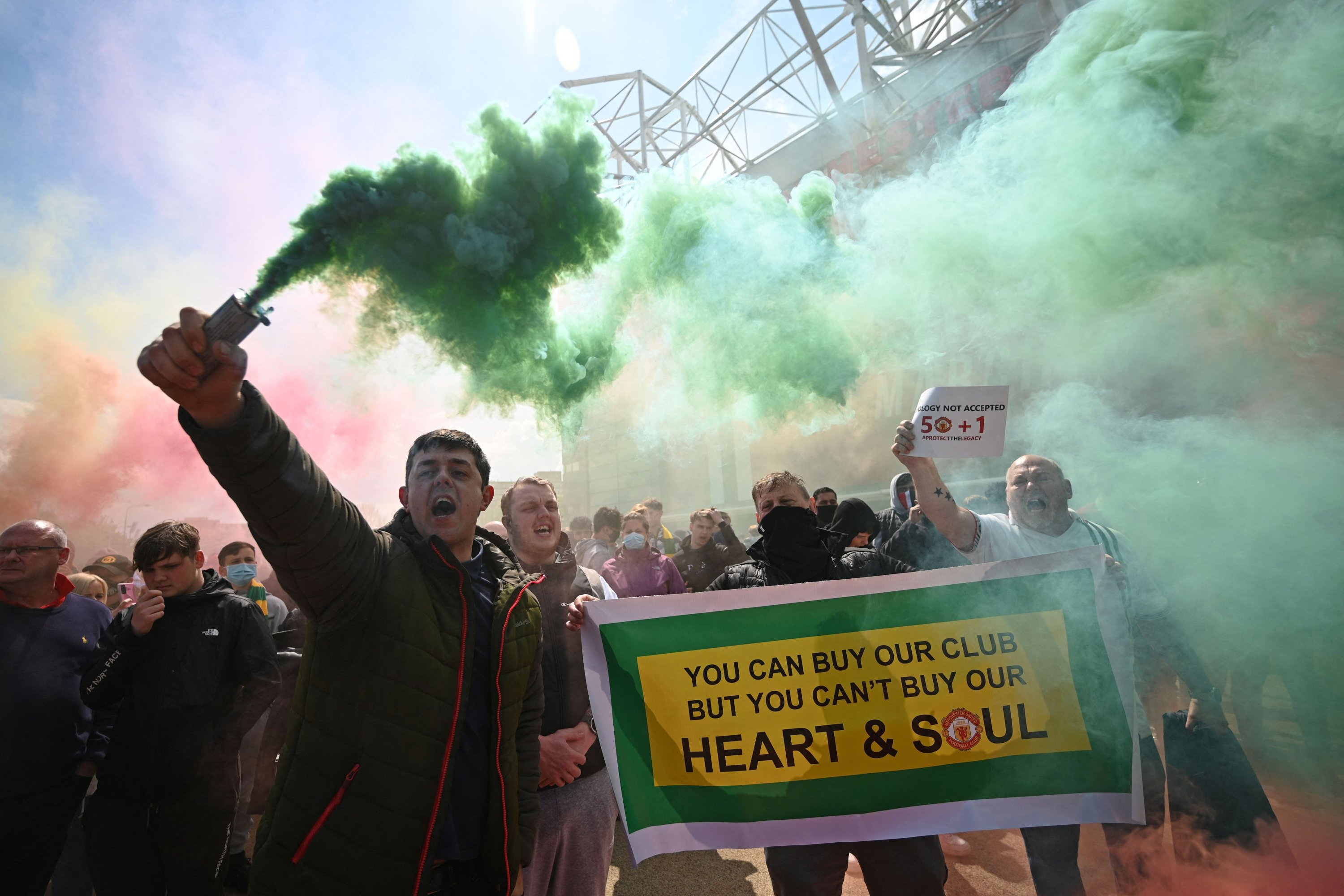 Manchester United supporters protest against the club owners outside the Old Trafford stadium in Manchester, northwest England, May 2, 2021. (AFP Photo)