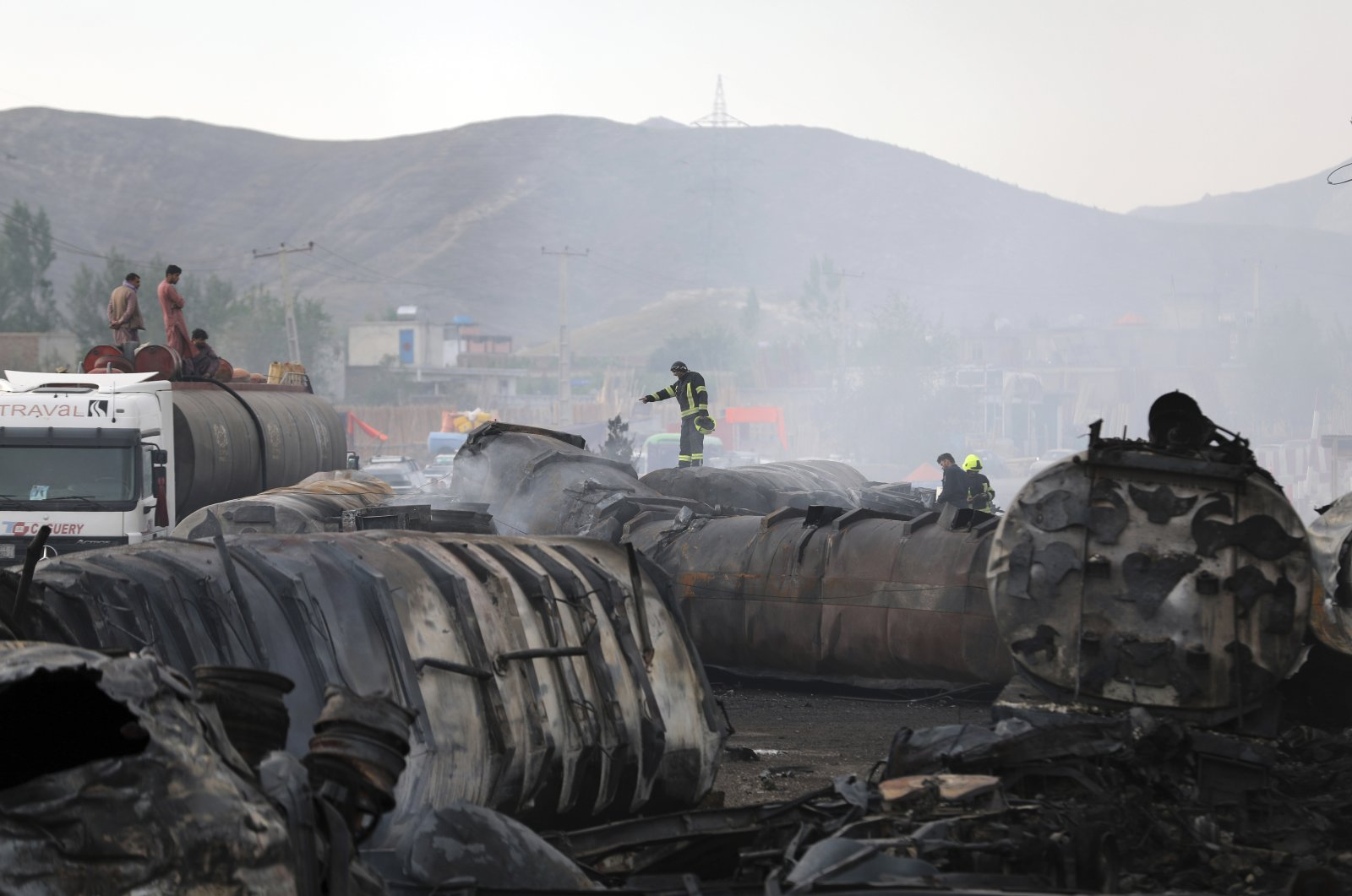 Firefighters work to extinguish a burning fuel tanker in Kabul, Afghanistan, Sunday, May 2, 2021. (AP Photo)