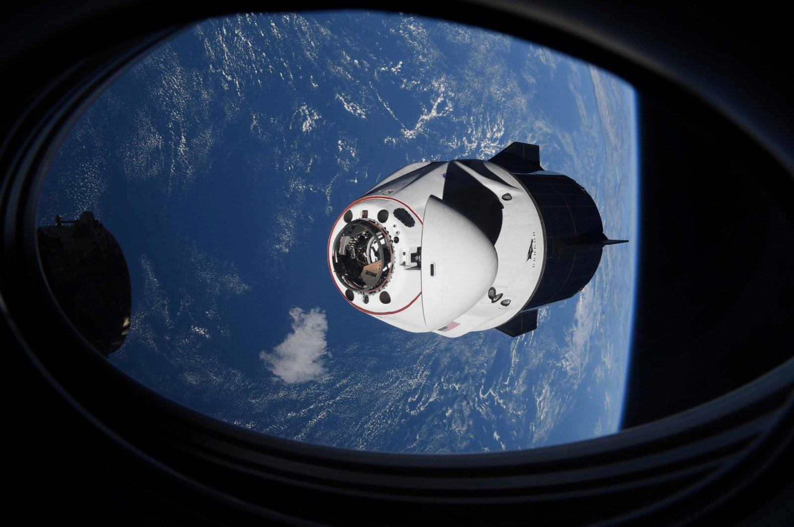 The SpaceX Crew Dragon capsule Endeavor, carrying four astronauts, approaches the International Space Station orbiting the Earth, April 24, 2021. (Reuters Photo)