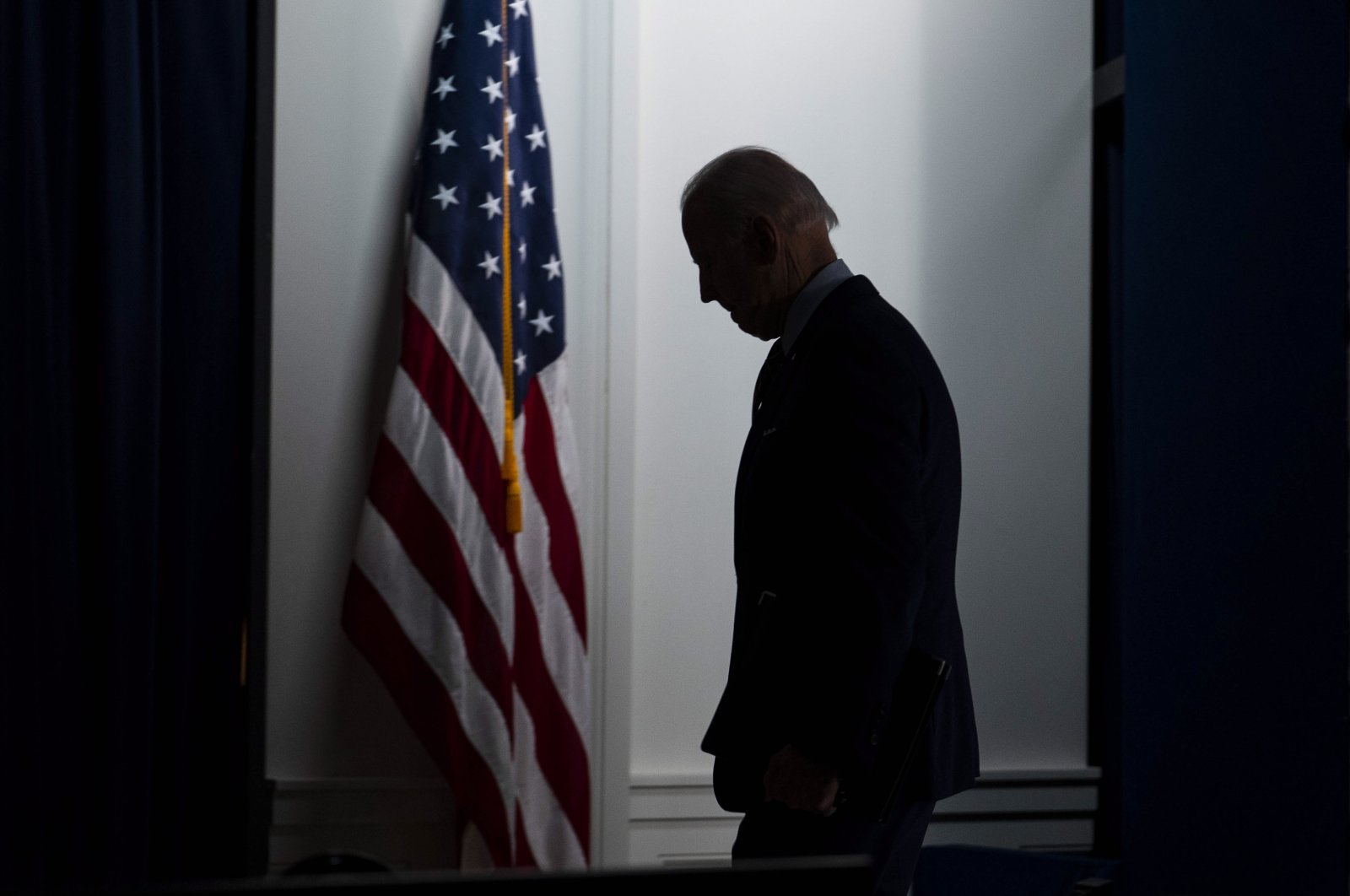 U.S. President Joe Biden walks off stage in the Eisenhower Executive Office Building in Washington, D.C., the U.S., April 21, 2021. (EPA Photo)