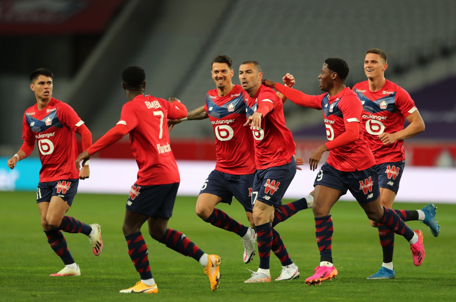 Lille's Burak Yılmaz (C) celebrates scoring his team's first goal with teammates againstNice at Stade Pierre-Mauroy, Lille, France, May 1, 2021.