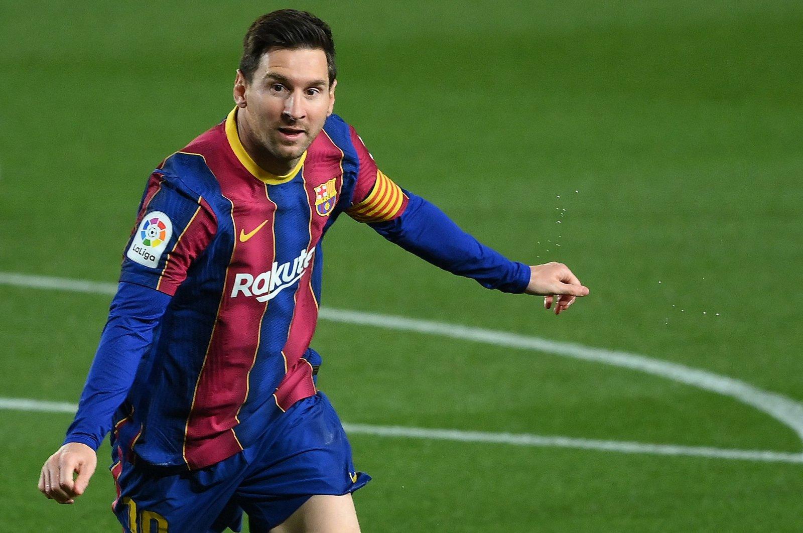 Barcelona's Argentinian forward Lionel Messi celebrates after scoring a goal against Getafe at the Camp Nou stadium, Barcelona, Spain, April 22, 2021. (AFP Photo)