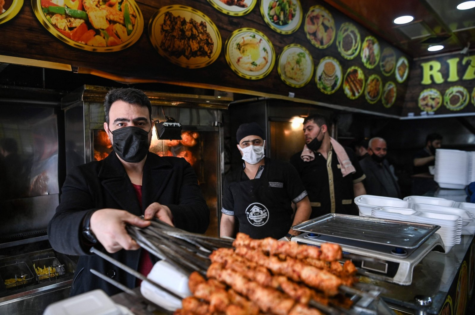 Syrian restaurant owner Ismail Abtini (L), 42, poses during an interview, in Gaziantep, Turkey, Feb. 25, 2021. (AFP)
