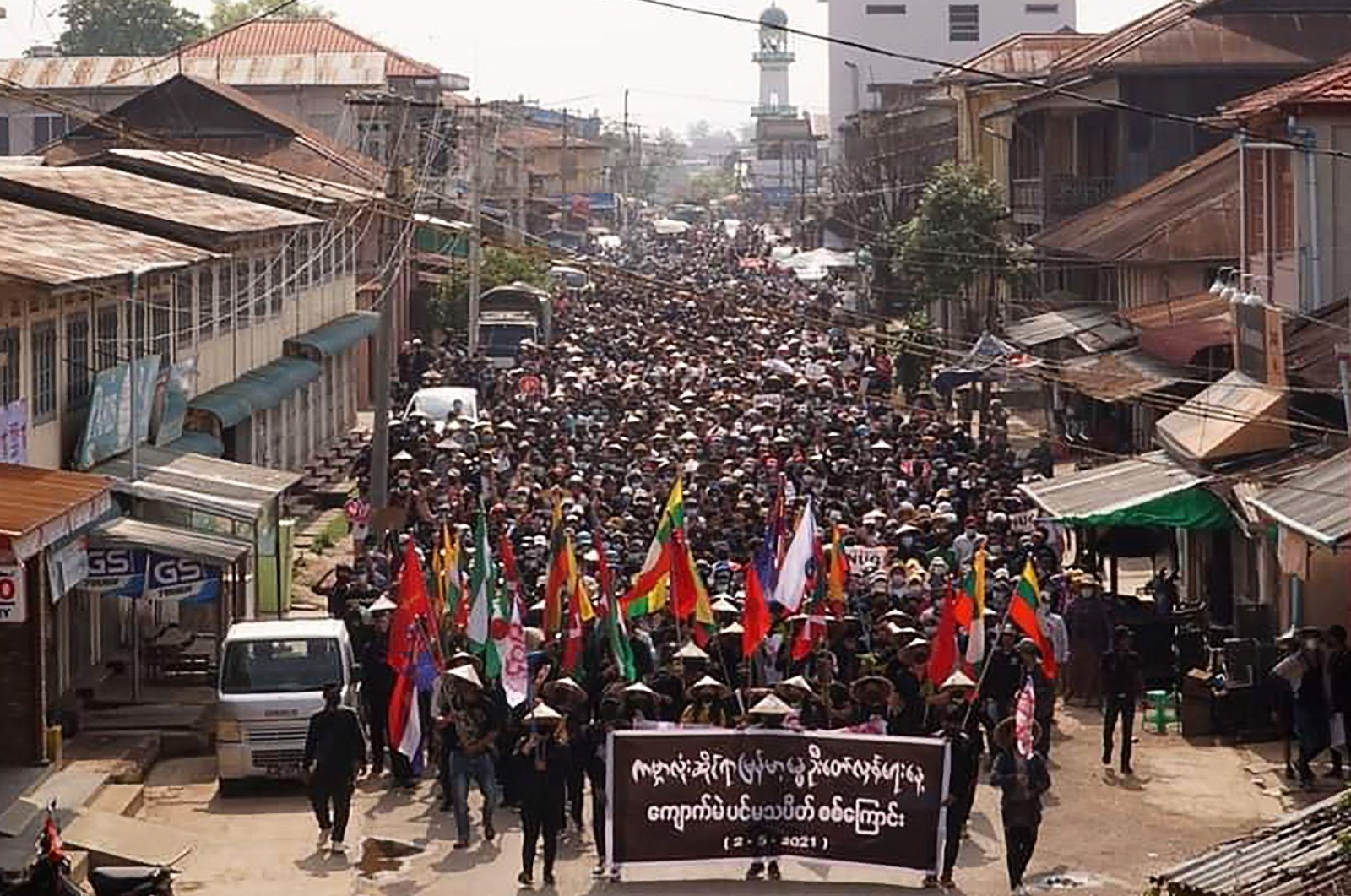 """Protesters take part in a demonstration against the military coup on """"Global Myanmar Spring Revolution Day"""" in Kyaukme, Shan State, Myanmar, May 2, 2021. (AFP Photo/Shwe Phee Myay News Agency)"""