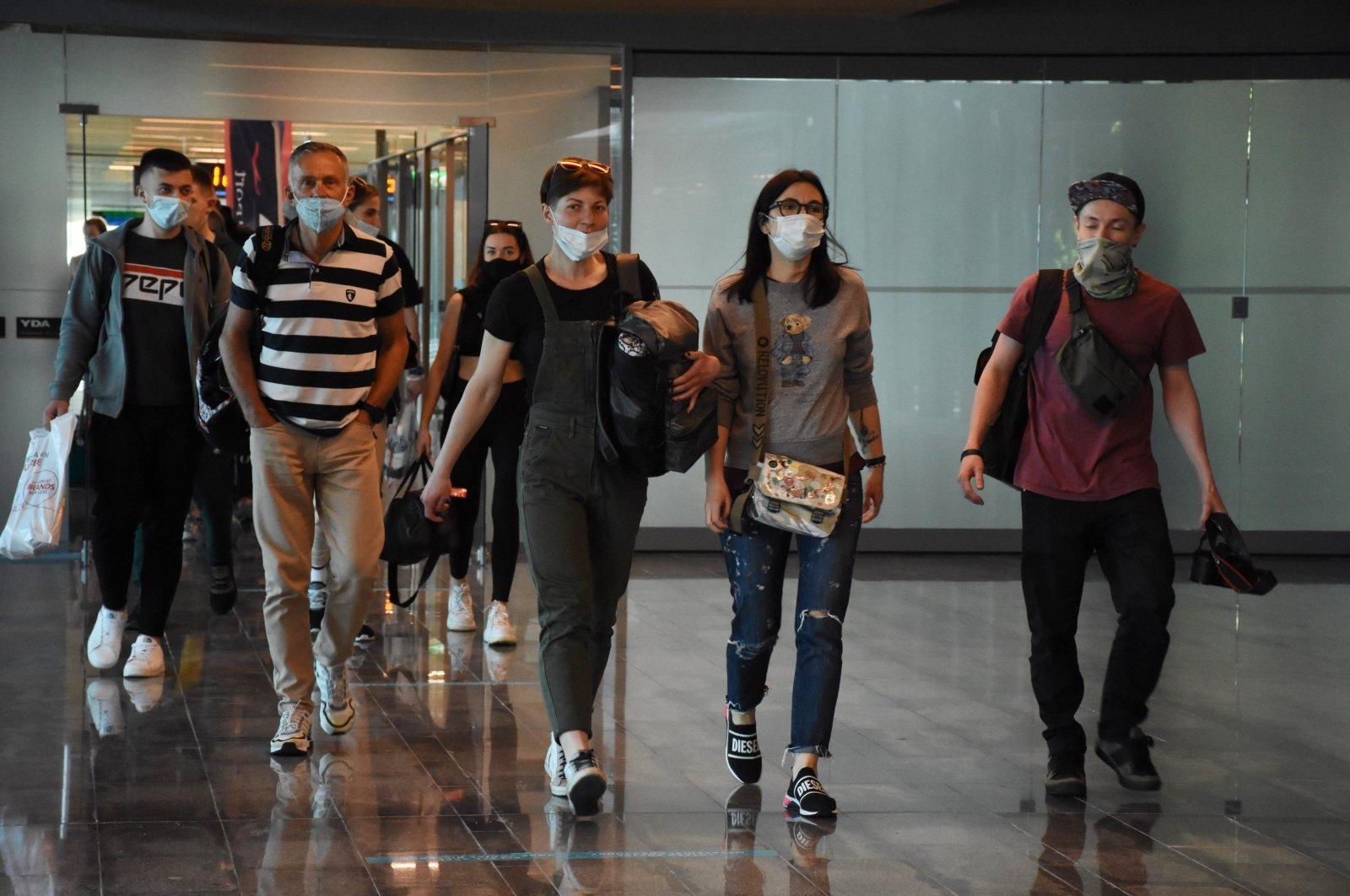 Ukrainian tourists arrive at Dalaman Airport, Muğla, southwestern Turkey, April 30, 2021. (AA Photo)