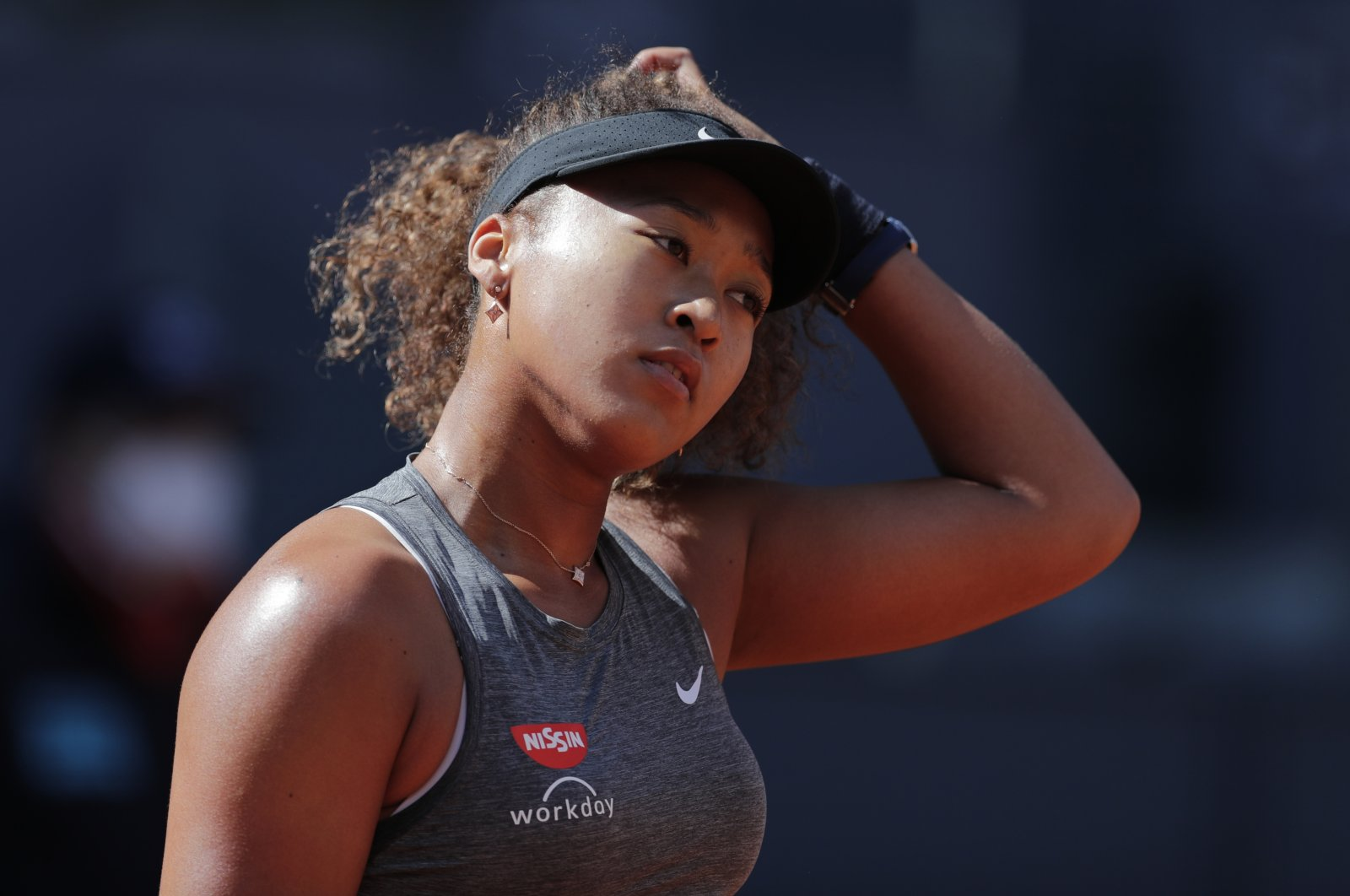 Japan's Naomi Osaka reacts during her match against the Czech Republic's Karolina Muchova at the Madrid Open, Madrid, Spain, May 2, 2021. (AP Photo)