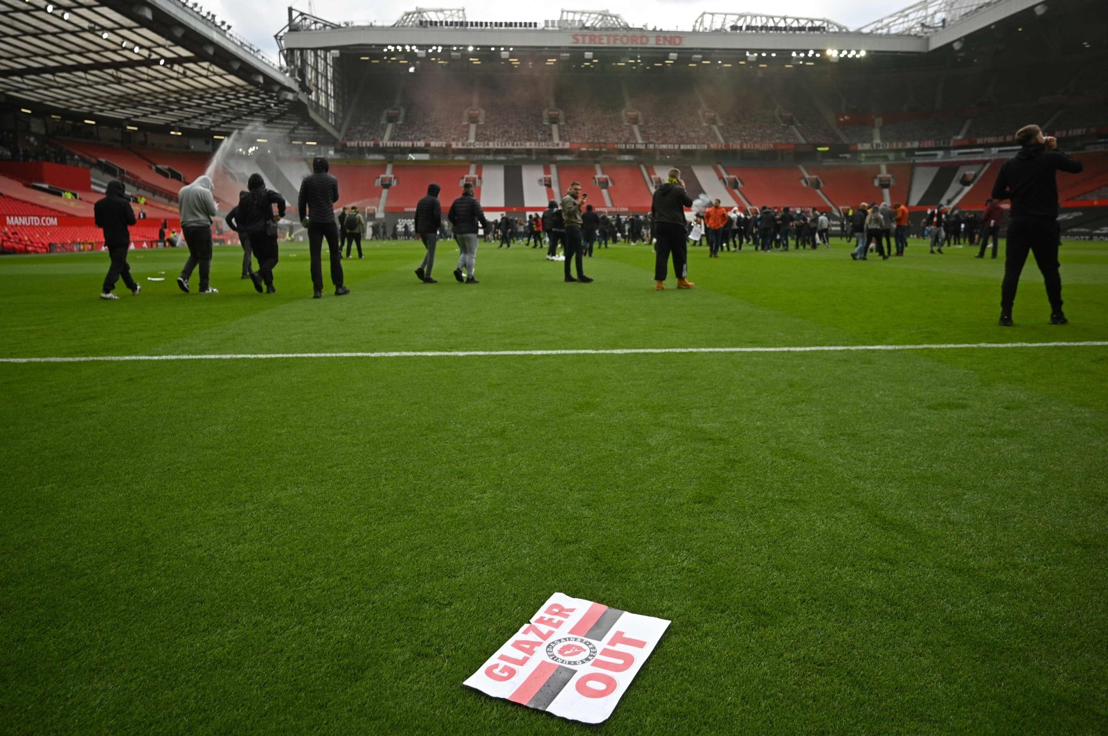 Supporters protest against Manchester United's owners inside the Old Trafford stadium in Manchester, northwest England, May 2, 2021. (AFP Photo)