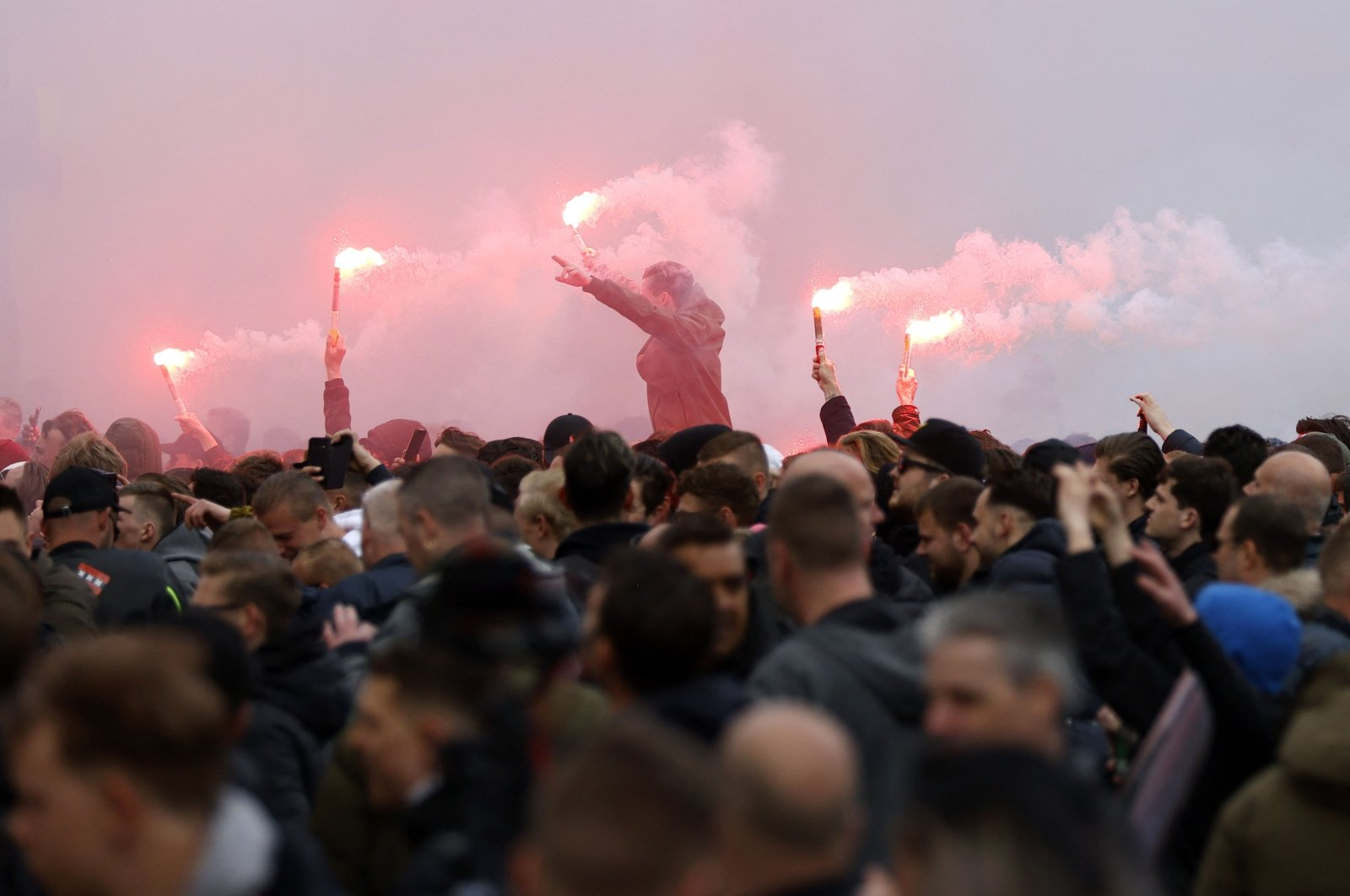 Ajax supporters burn flares in Amsterdam as they celebrate their team winning its 35th national title following the Dutch Eredivisie football match between Ajax Amsterdam and FC Emmen, Amsterdam, Netherlands, May 2, 2021. (AFP Photo)
