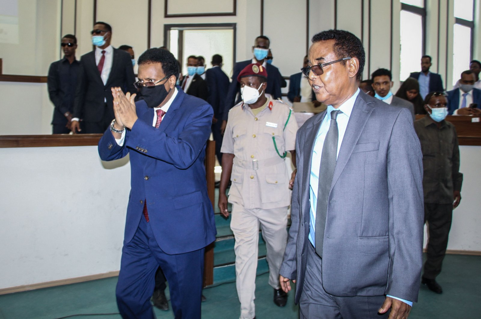 Somalia's President Mohamed Abdullahi Mohamed (L), commonly known by his nickname of Farmajo, attends the special assembly for abandoning the two-year extension of his presidential term and requesting the immediate election to ease the recent political tension at Villa Hargeisa in Mogadishu, Somalia, May 1, 2021. (AFP Photo)