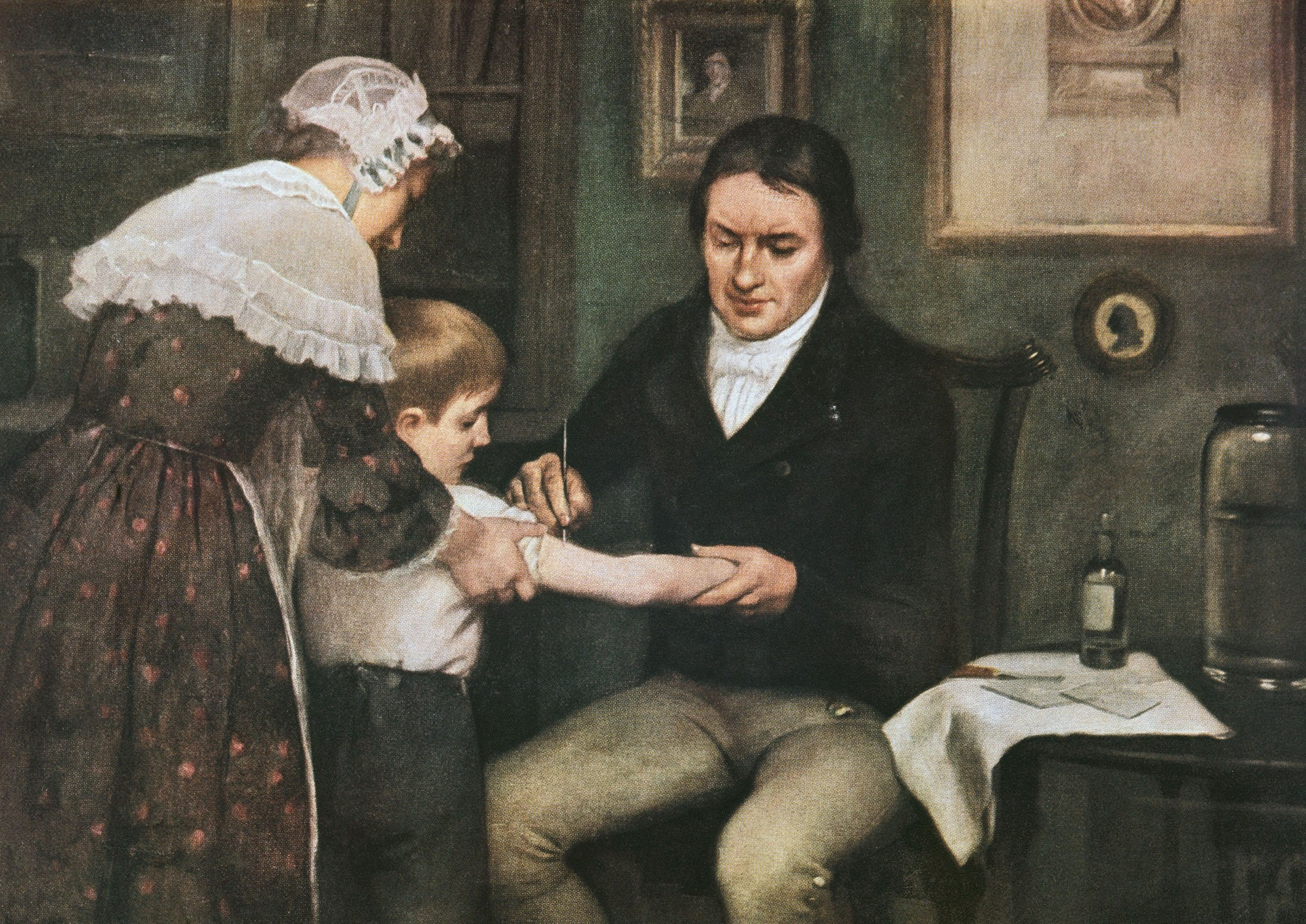 Dr. Edward Jenner (1749-1823) performing his first vaccination against smallpox on James Phipps, a boy of 8, May 14, 1796, oil on canvas by Ernest Board (1877-1934), 1920-1930, U.K. (Getty Images)