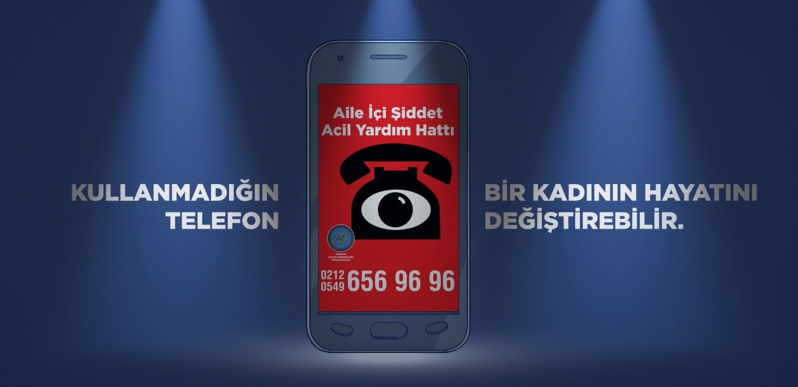 """A poster prepared for the """"A phone can save a woman's life"""" project, in Istanbul, Turkey. (DHA Photo)"""