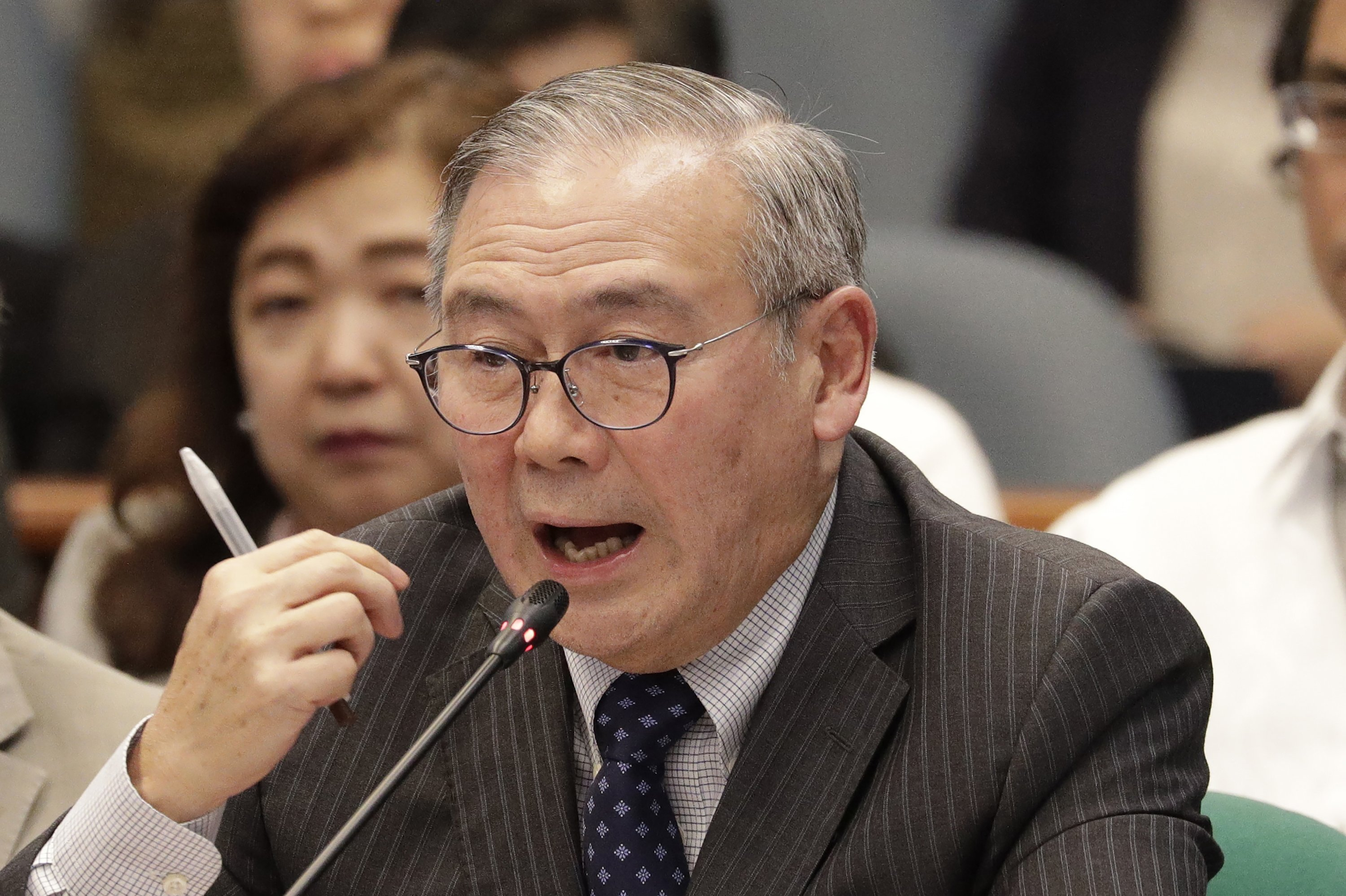 Philippine Secretary of Foreign Affairs Teodoro Locsin Jr. gestures during a senate hearing in Manila, Philippines, Feb. 6, 2020. (AP Photo)