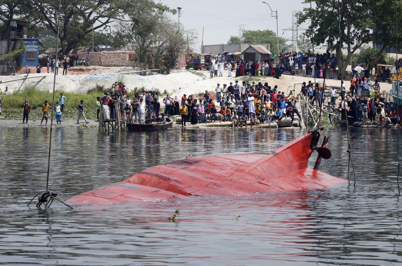 Locals gather to watch the aftermath of a boat capsizing in theShitalakkhya river in Narayanganj, Dhaka, Bangladesh, April 5, 2021. (EPA Photo)