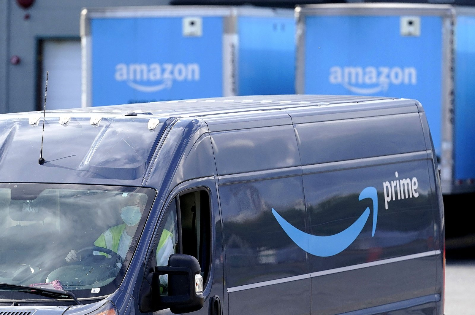 An Amazon Prime logo is seen on the side of a delivery van as it departs an Amazon Warehouse location in Dedham, Mass., U.S., Oct. 1, 2020. (AP Photo)