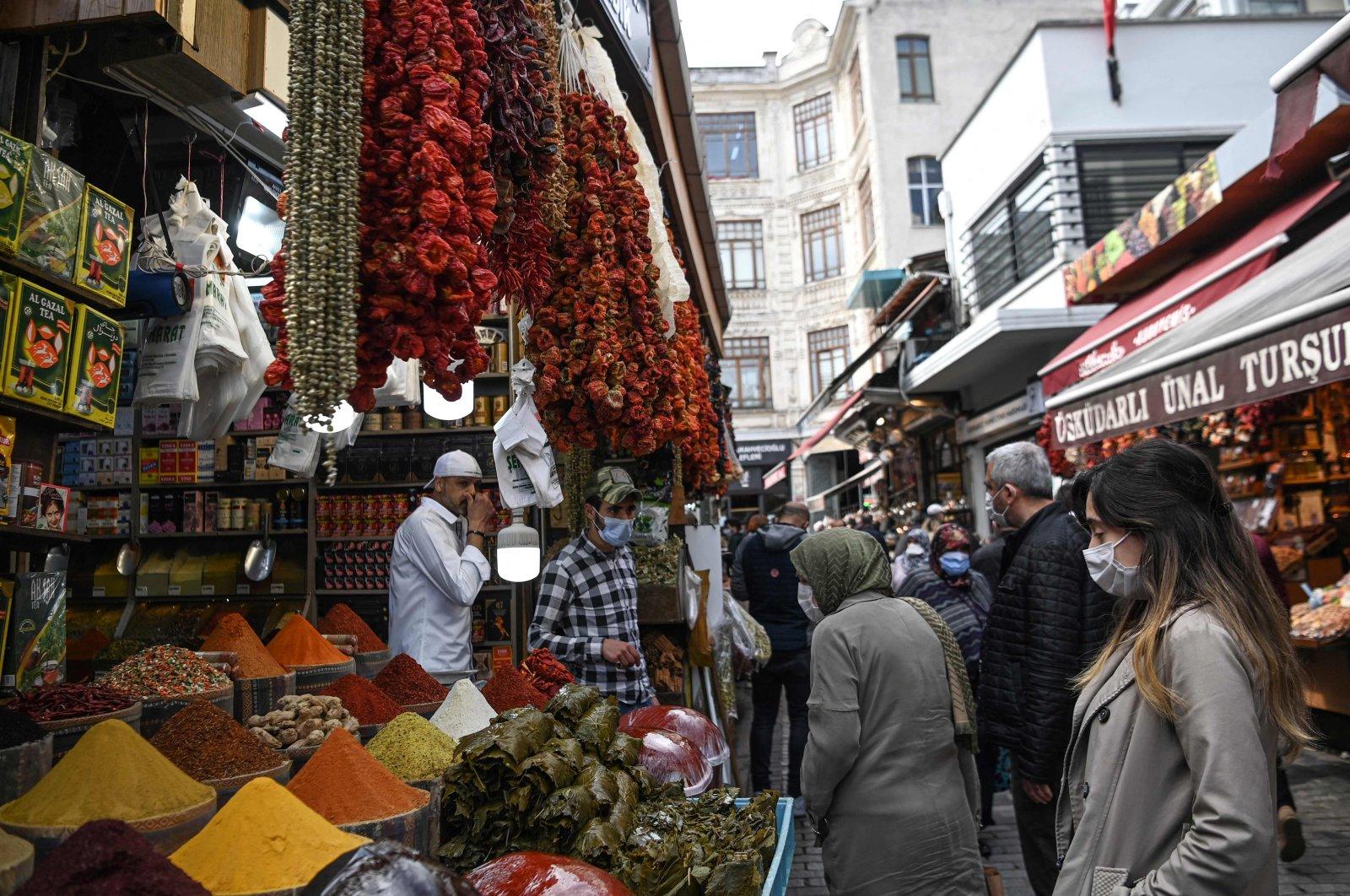People shop near the Spice Bazaar in the Eminönü neighborhood on the European side of Istanbul, Turkey, April 27, 2021. (AFP Photo)