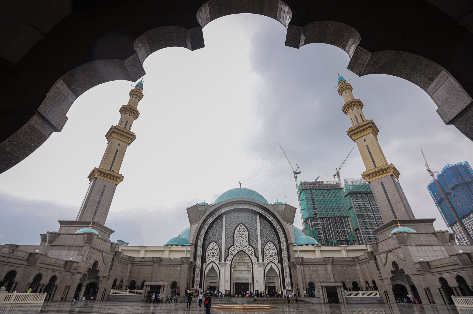 Worshippers leave Wilayah Mosque after their prayers on the first Friday of the holy month of Ramadan, Kuala Lumpur, Malaysia, April 16, 2021. (Photo by Getty Images)
