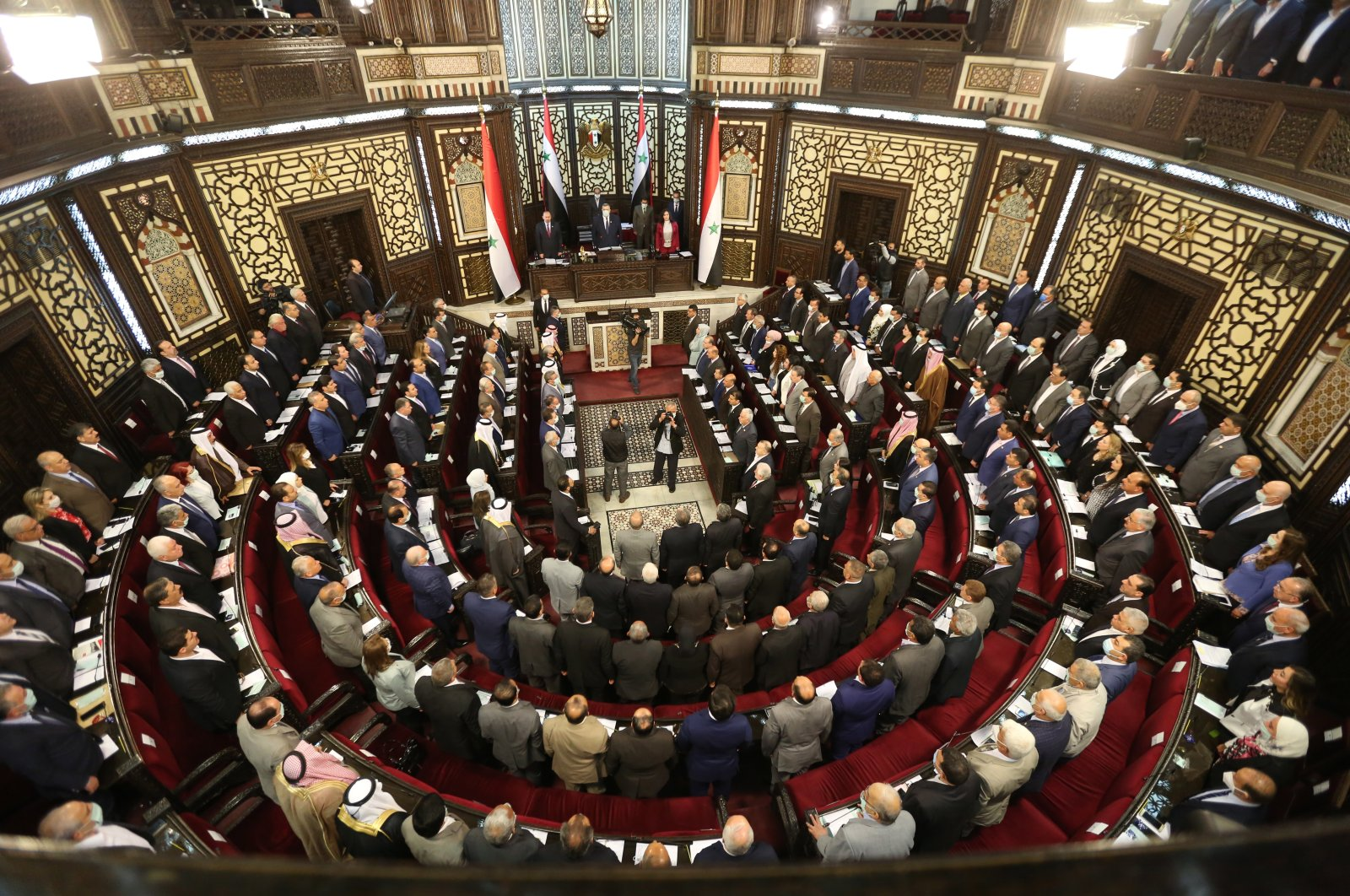 A general view of members of the Syrian parliament attending an extraordinary session in Damascus, Syria, April 18, 2021. (EPA Photo)