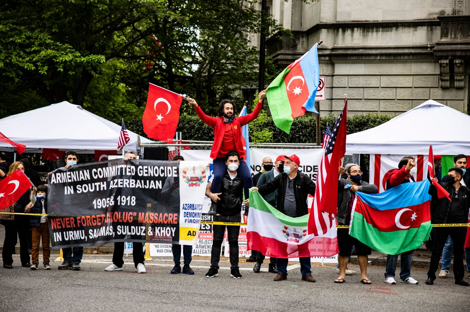 A group of Turkish protestors stands outside the Turkish ambassador's residence across from Armenian protestors on the 106th anniversary of the 1915 Armenian Events in Washington, D.C., U.S., April 24, 2021. (AFP Photo)