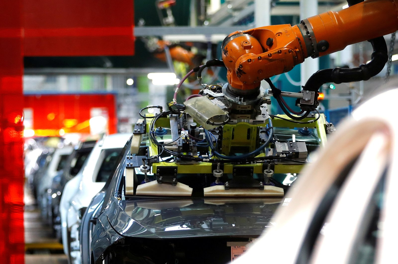 A robot engineered by Kuka adjusts a windscreen in a fully automated process on a model of the A-class production line of German car manufacturer Mercedes Benz at the Daimler factory in Rastatt, Germany, Feb. 4, 2019. (Reuters Photo)