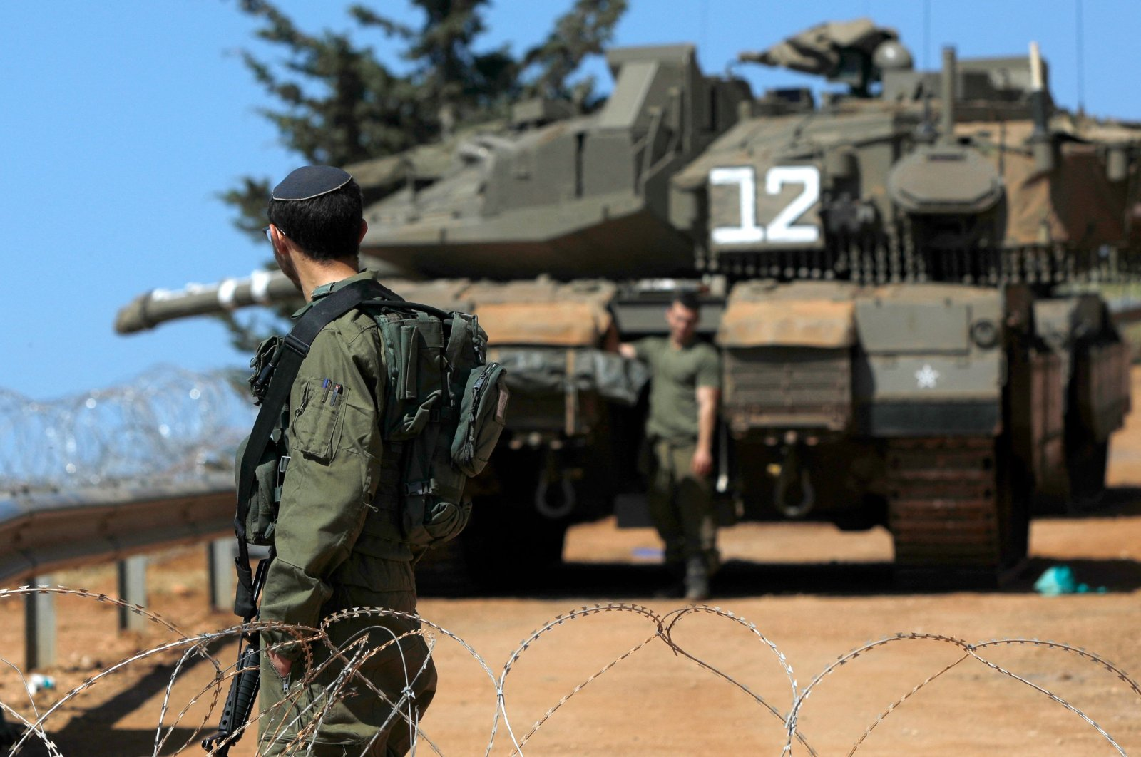 Israeli soldiers are pictured stationed near the northern Israeli kibbutz of Malkia along the Lebanese border, April 28, 2021. (AFP Photo)