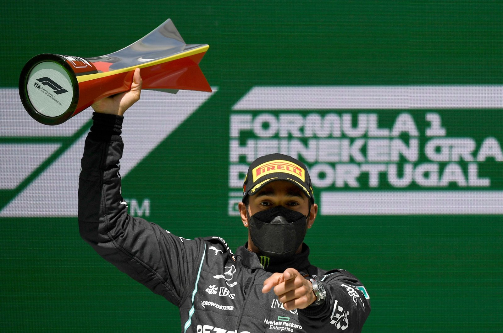 Mercedes' British driver Lewis Hamilton celebrates on the podium after winning the Portuguese Formula One Grand Prix race at the Algarve International Circuit in Portimao, Portugal, May 2, 2021. (AFP Photo)