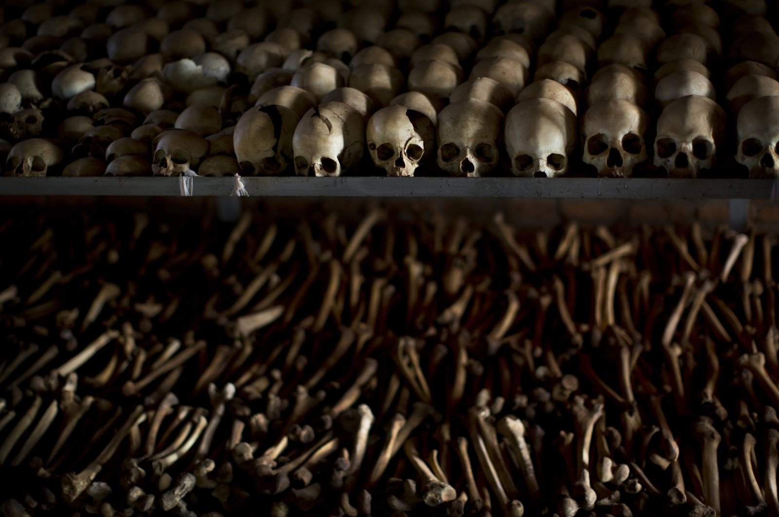 The skulls and bones of some of those who were slaughtered are laid out as a memorial to the thousands who were killed in and around the Catholic church during the 1994 genocide in Ntarama, Rwanda, April 4, 2014. (AP Photo)