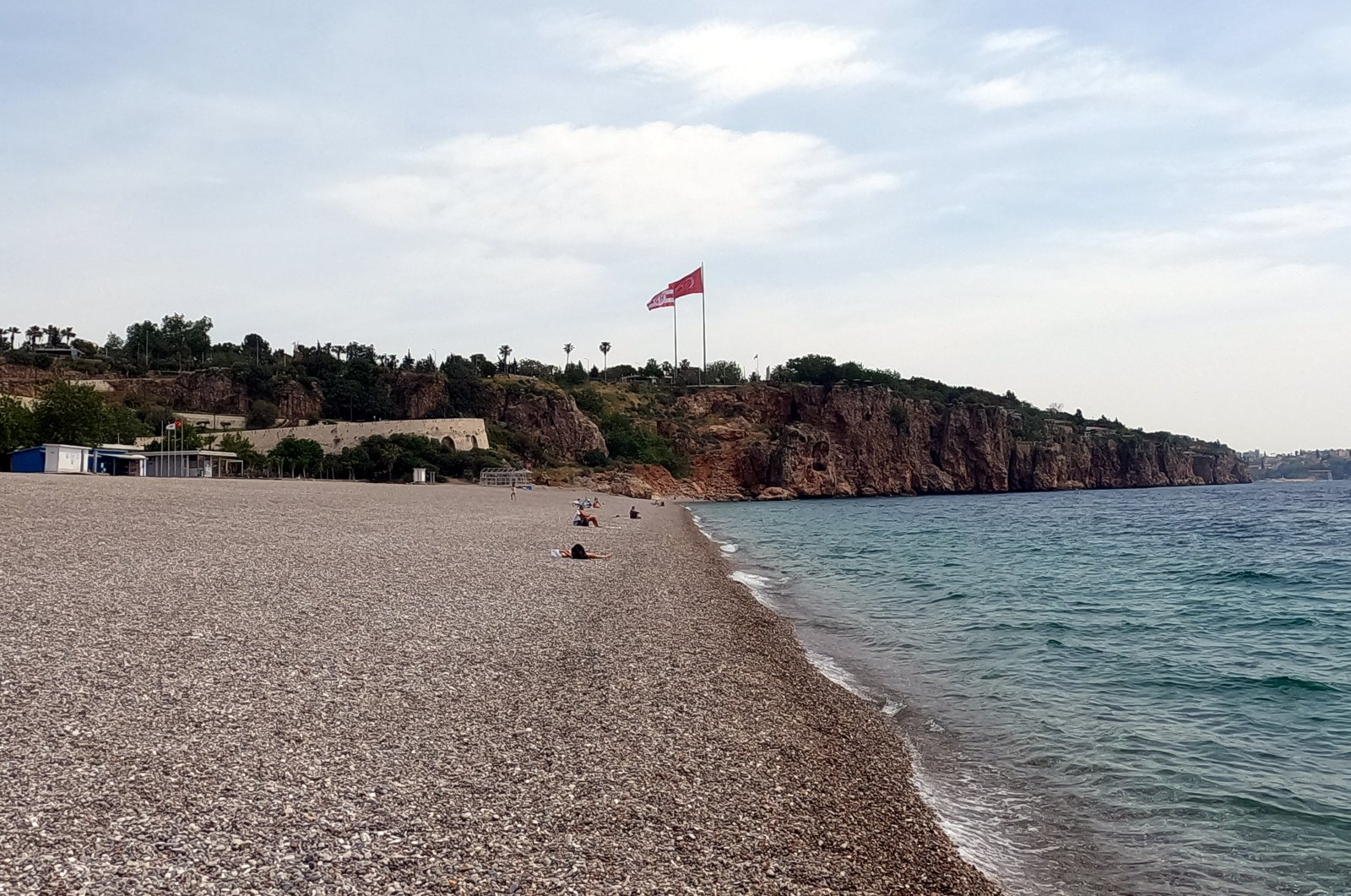 The renowned Konyaaltı Beach of Antalya, southern Turkish city dubbed as the country's tourism capital, is seen empty during a 17-day lockdown to reduce COVID-19 cases, Antalya, Turkey, May 3, 2021. (AA Photo)