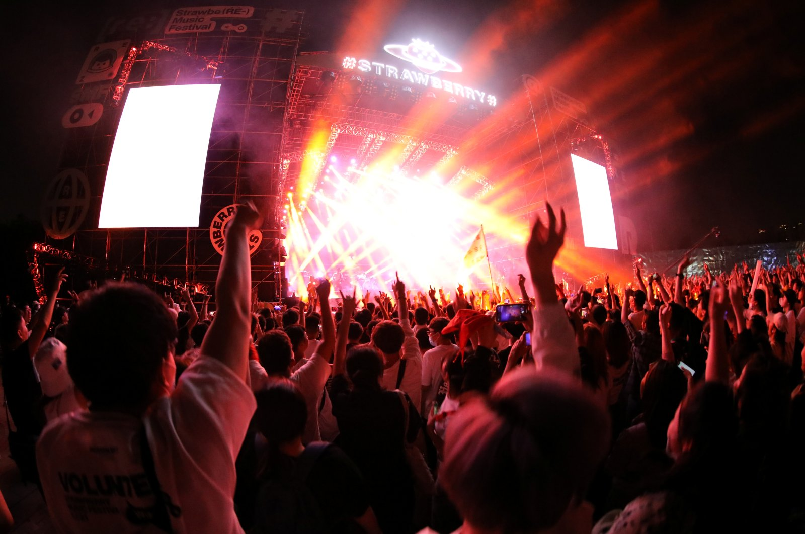 Fans attend a performance of a rock band at the Strawberry Music Festival during the Labor Day holiday in Wuhan, Hubei Province, China, May 1, 2021. (Reuters Photo)