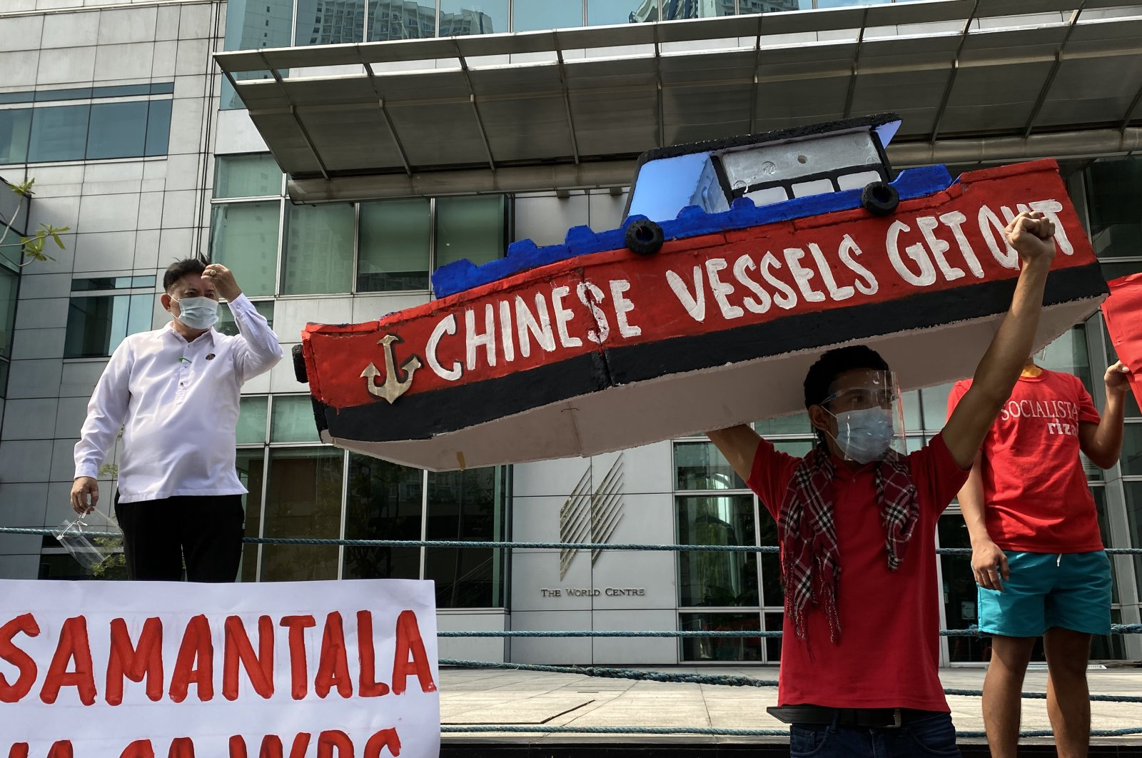 Filipino demonstrators stage a protest rally to denounce the continued intrusion of Chinese patrol ships inside the Philippine territory in the disputed South China sea, in front of the Chinese Consulate in Manila, Philippines, April 23, 2021. (EPA)