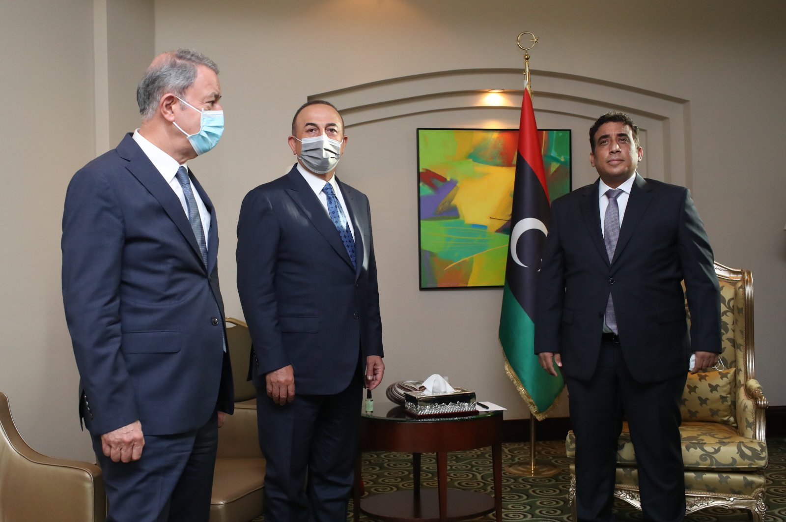 From left to right, Defense Minister Hulusi Akar, Foreign Minister Mevlüt Çavuşoğlu and head of Libya's Presidential Council, Mohammad Younes Menfi meet in Tripoli, Libya, May 3, 2021. (AA Photo)