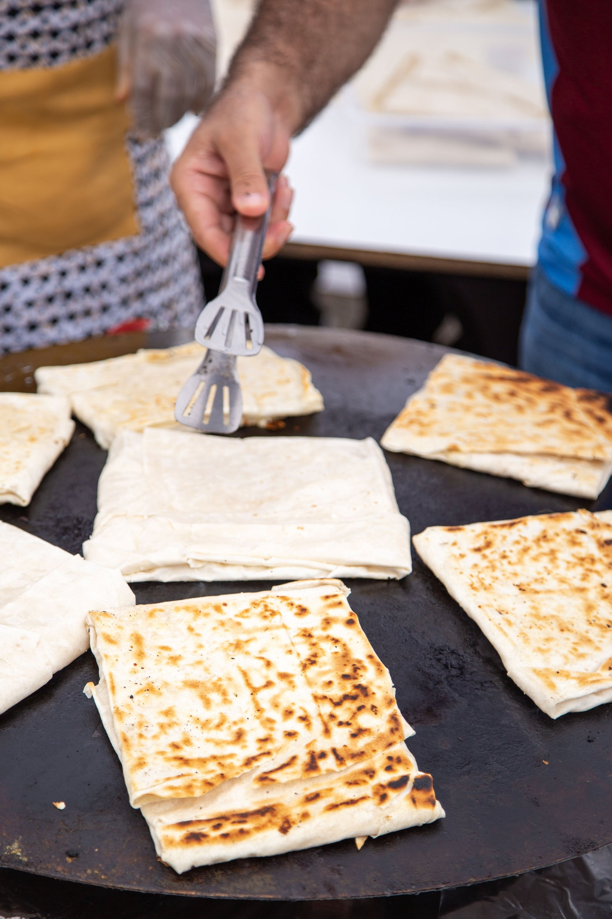 Traditional Turkish gözleme is cooked on a concave disc-shaped griddle called sac. (Shutterstock Photo)